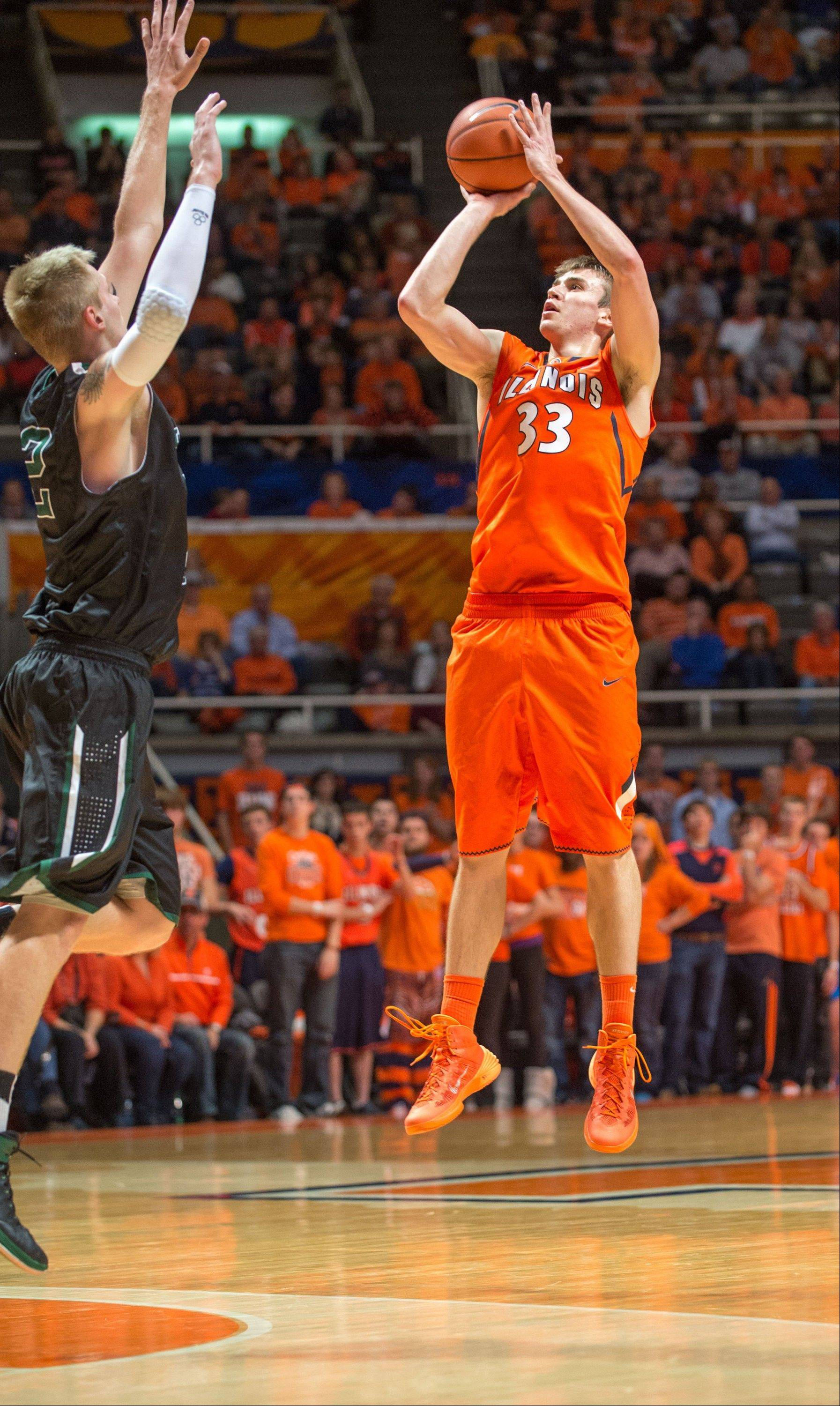 Illinois' Jon Ekey puts up a three-point basket past Chicago State's Matt Ross during the second half of Friday's game in Champaign.