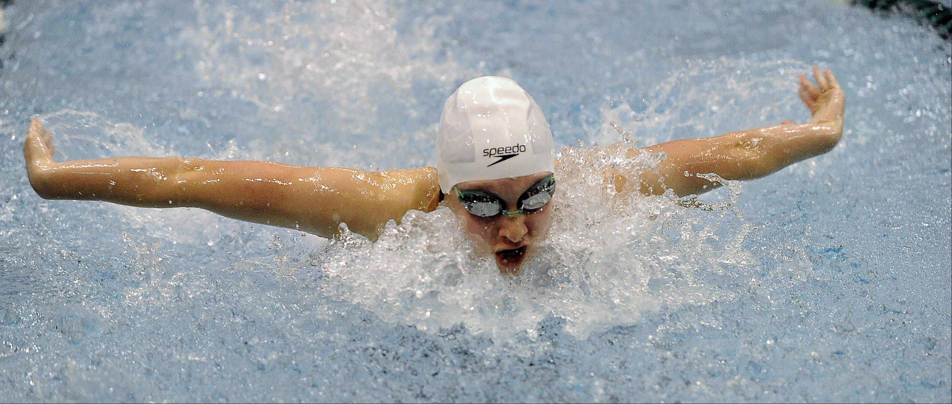 Sarah Hanning of the Bartlett/Streamwood co-op competes in the 100-yardd butterfly at the girls state finals prelims at New Trier High School on Friday.