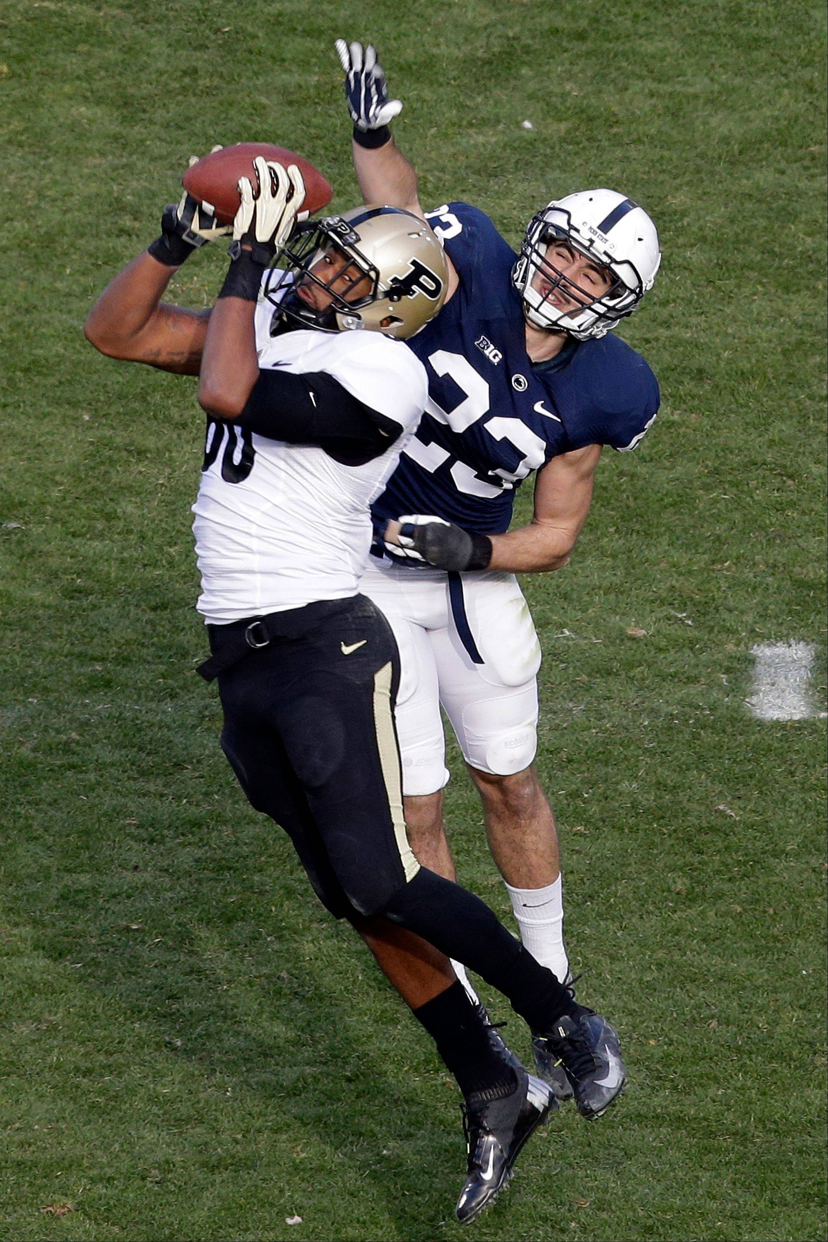 Purdue wide receiver DeAngelo Yancey hauls in a pass in front of Penn State safety Ryan Keiser for a 15-yard gain during the third quarter of last Saturday's game in State College, Pa.