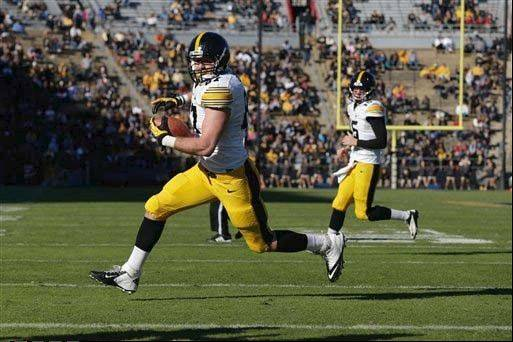 Iowa tight end Jake Duzey runs in for a touchdown during a Nov. 9 win over Purdue.