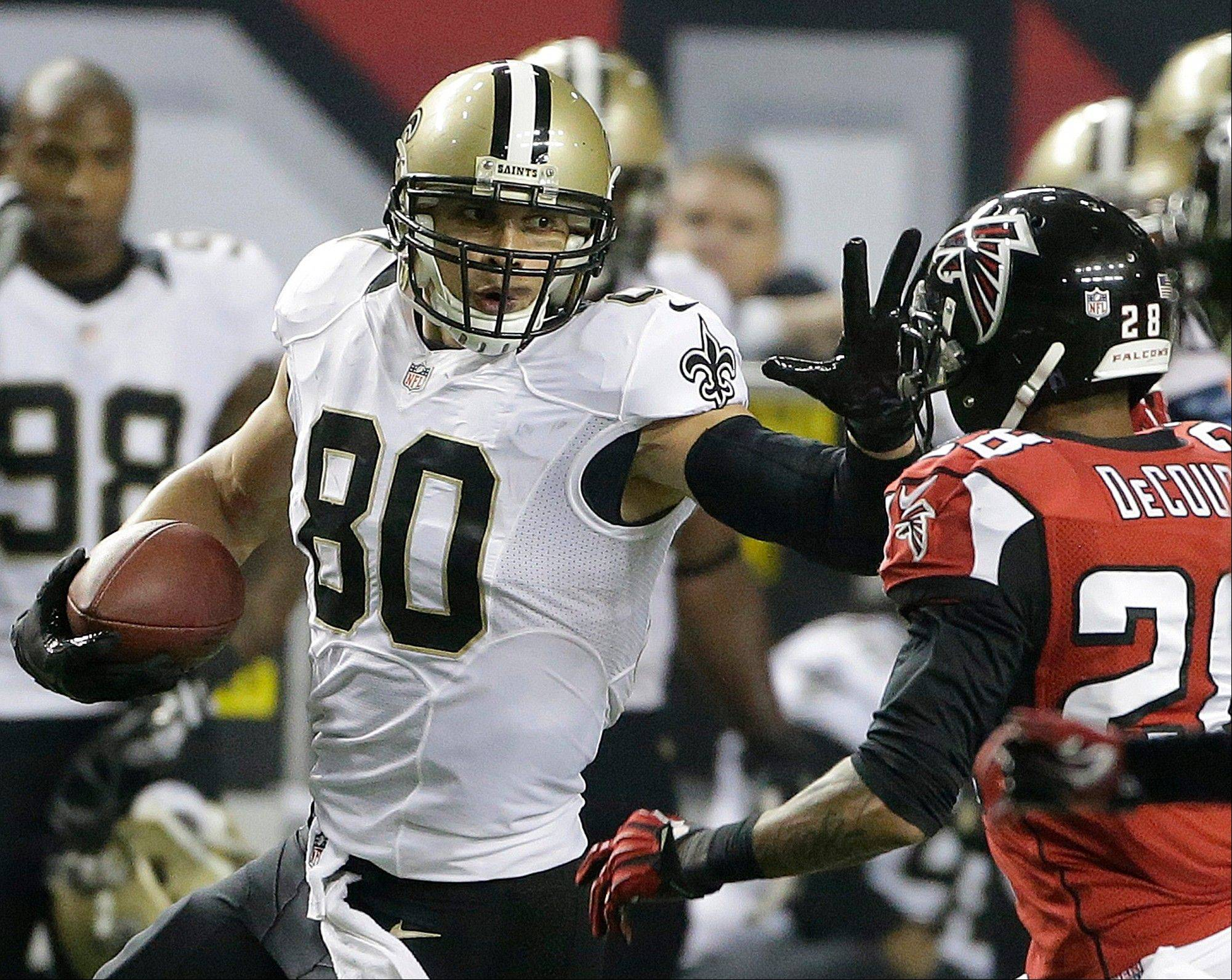 New Orleans Saints tight end Jimmy Graham (80) prepares to stop Atlanta Falcons free safety Thomas DeCoud (28) during the second half of an NFL football game, Thursday, Nov. 21, 2013, in Atlanta.