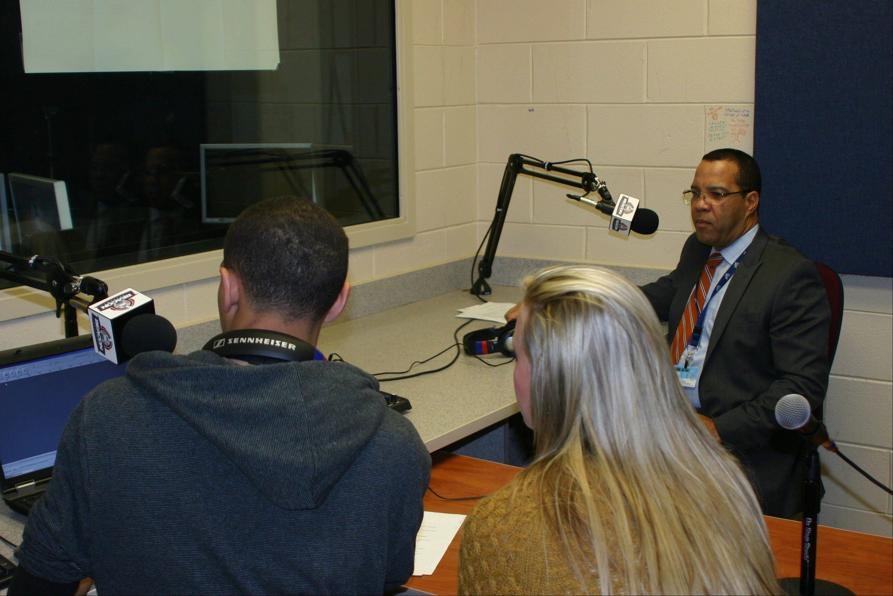 BEACON Academy seniors Ryan Jenkins, left, and Briana Cullen, right, interview U-46 Superintendent Dr. Jos� Torres for the district's relaunch radio show on WEPS 88.9 FM.
