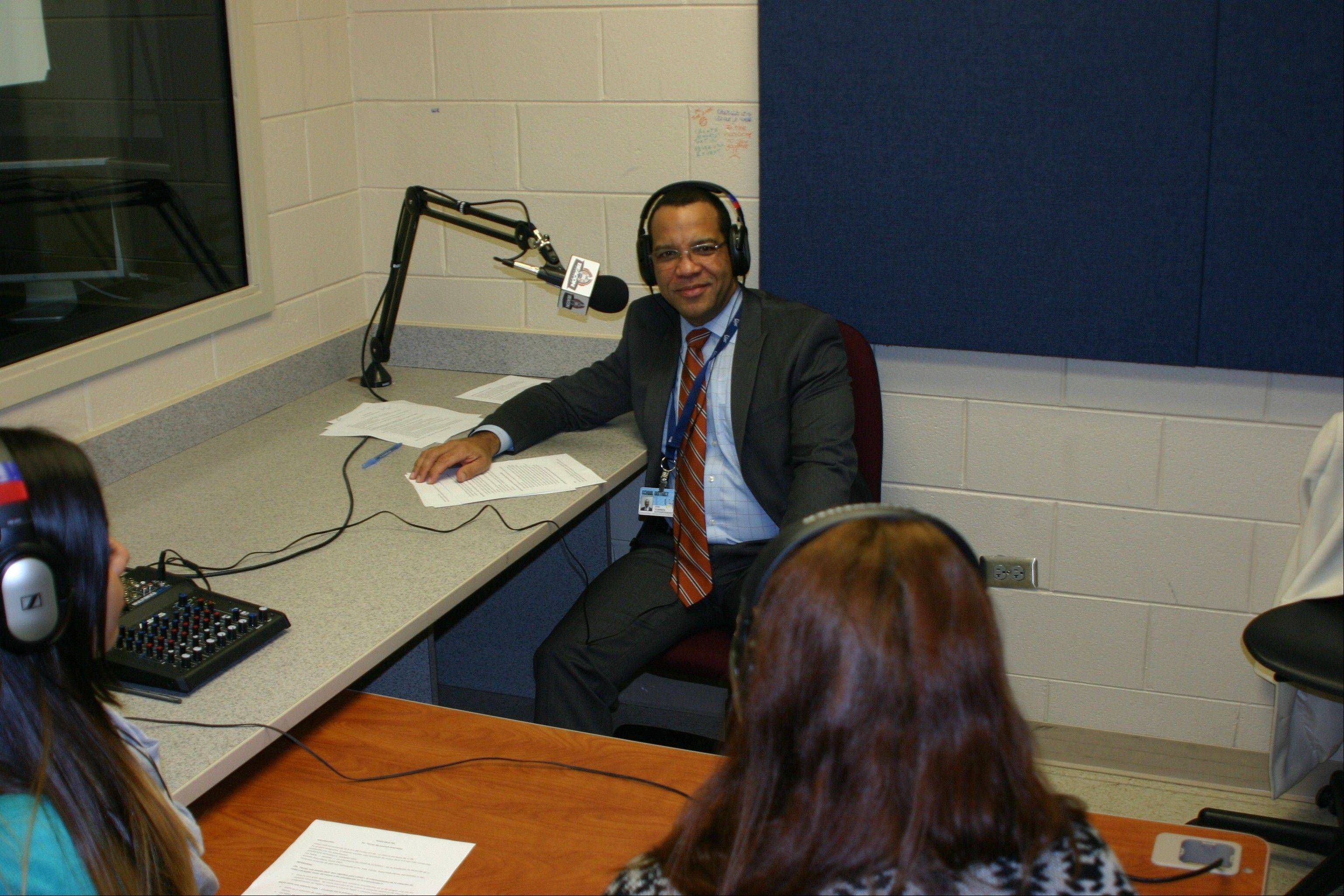 BEACON Academy seniors Tanya Ocampo, left, and Paula Lopez, right, interview U-46 Superintendent Dr. Jos� Torres in Spanish for the station's relaunch show on WEPS 88.9 FM Tuesday, Nov. 12.