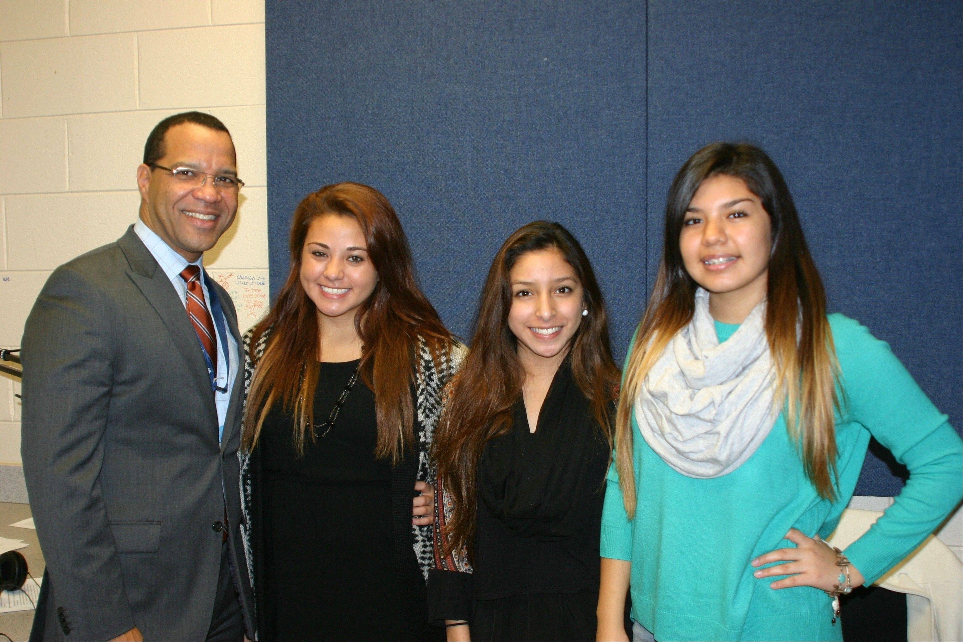 BEACON Academy seniors Paula Lopez, Lilia Vazquez and Tanya Ocampo interview U-46 Superintendent Dr. Jos� Torres in Spanish for the station's relaunch show on WEPS 88.9 FM. Pictured, from left, are: Dr. Torres, Paula Lopez, Lilia Vazquez, Tanya Ocampo.