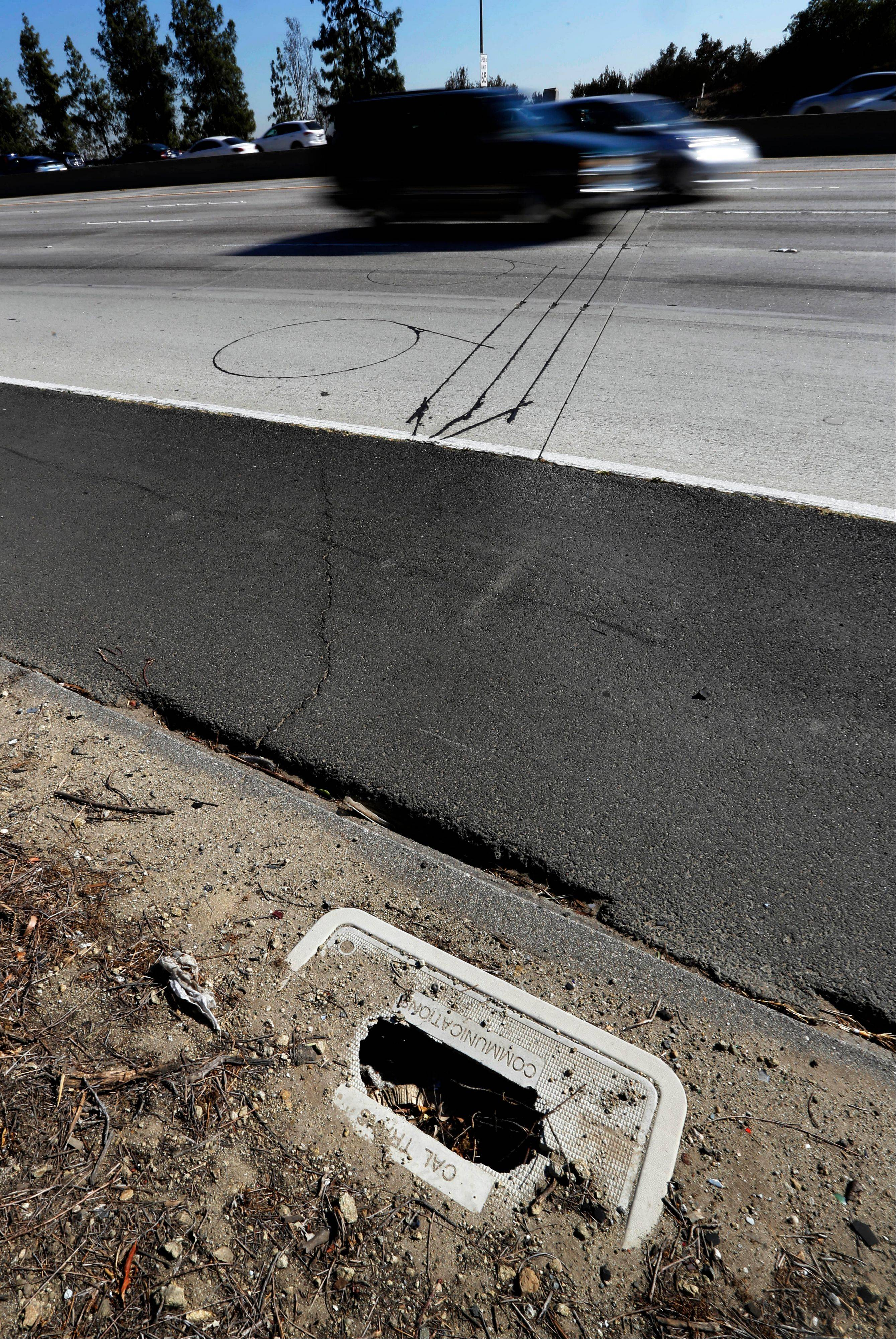 Cars pass over Caltrans traffic sensors on the State Route 134 Freeway in Los Angeles but the control box is damaged. About one-third of traffic sensors that Caltrans operates on highways statewide do not work.