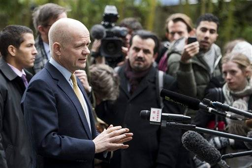 British Foreign Secretary William Hague speaks to journalists as he arrives at the Intercontinental Hotel prior to talks on Iran's nuclear program in Geneva, Switzerland, Saturday, Nov. 23, 2013. U.S. Secretary of State John Kerry and foreign ministers of other major powers joined Iran nuclear talks on Saturday, throwing their weight behind a diplomatic push to complete a deal after envoys reported progress on key issues blocking an interim agreement to curb the Iranian program in return for limited sanctions relief.