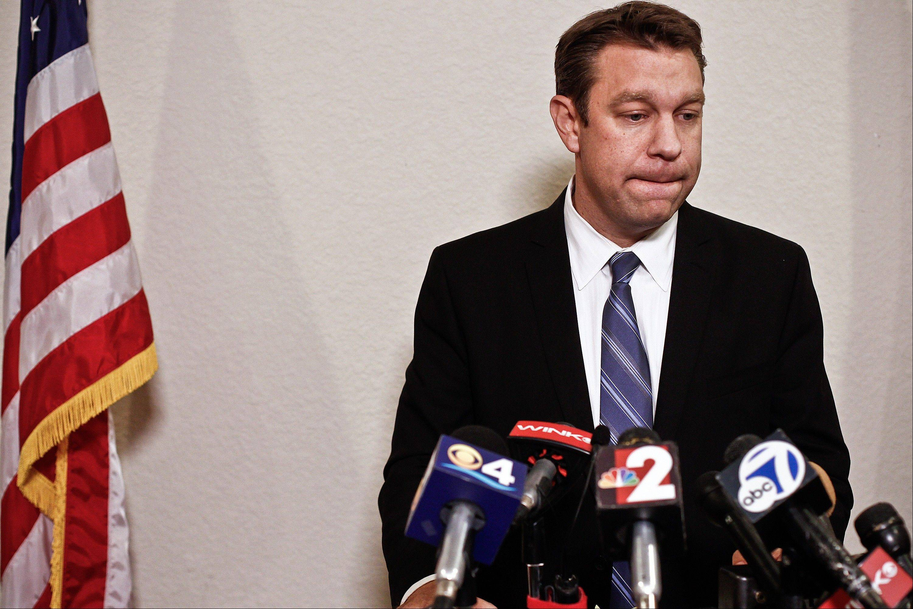 Congressman Trey Radel takes a moment to himself Wednesday as he addresses the media at his office in Cape Coral.
