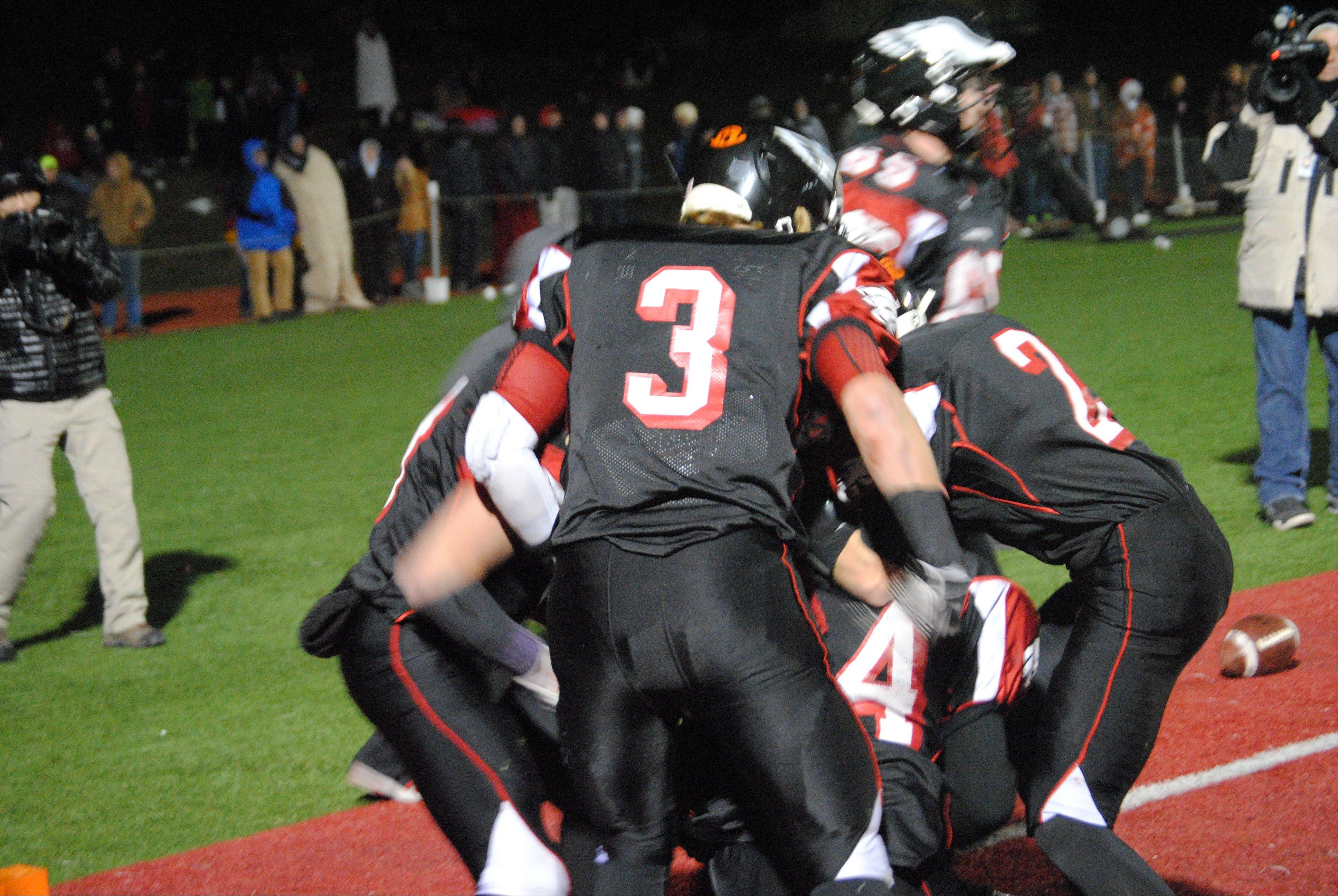 Aurora Christian tailback Legend Smith (44) getting mobbed by jubilant teammates after his 10-yard TD reception that gave the Eagles a 26-21 lead over Stillman Valley with 2:27 remaining during Saturday�s 3A state semifinals in Aurora. Stillman Valley rallied for a 28-26 win.