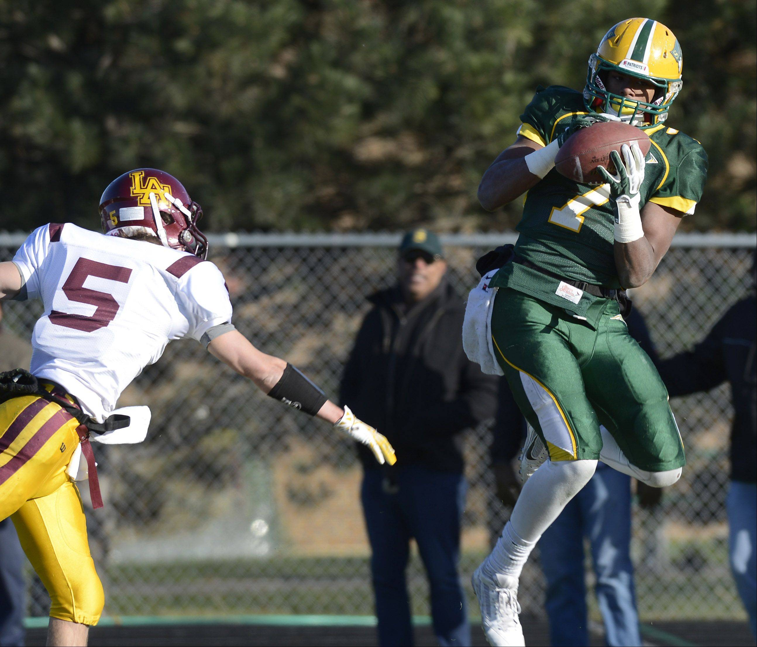 Stevenson�s Cameron Green makes a touchdown catch in front of Loyola�s Jack Gleason during Saturday�s class 8A semifinal in Lincolnshire.