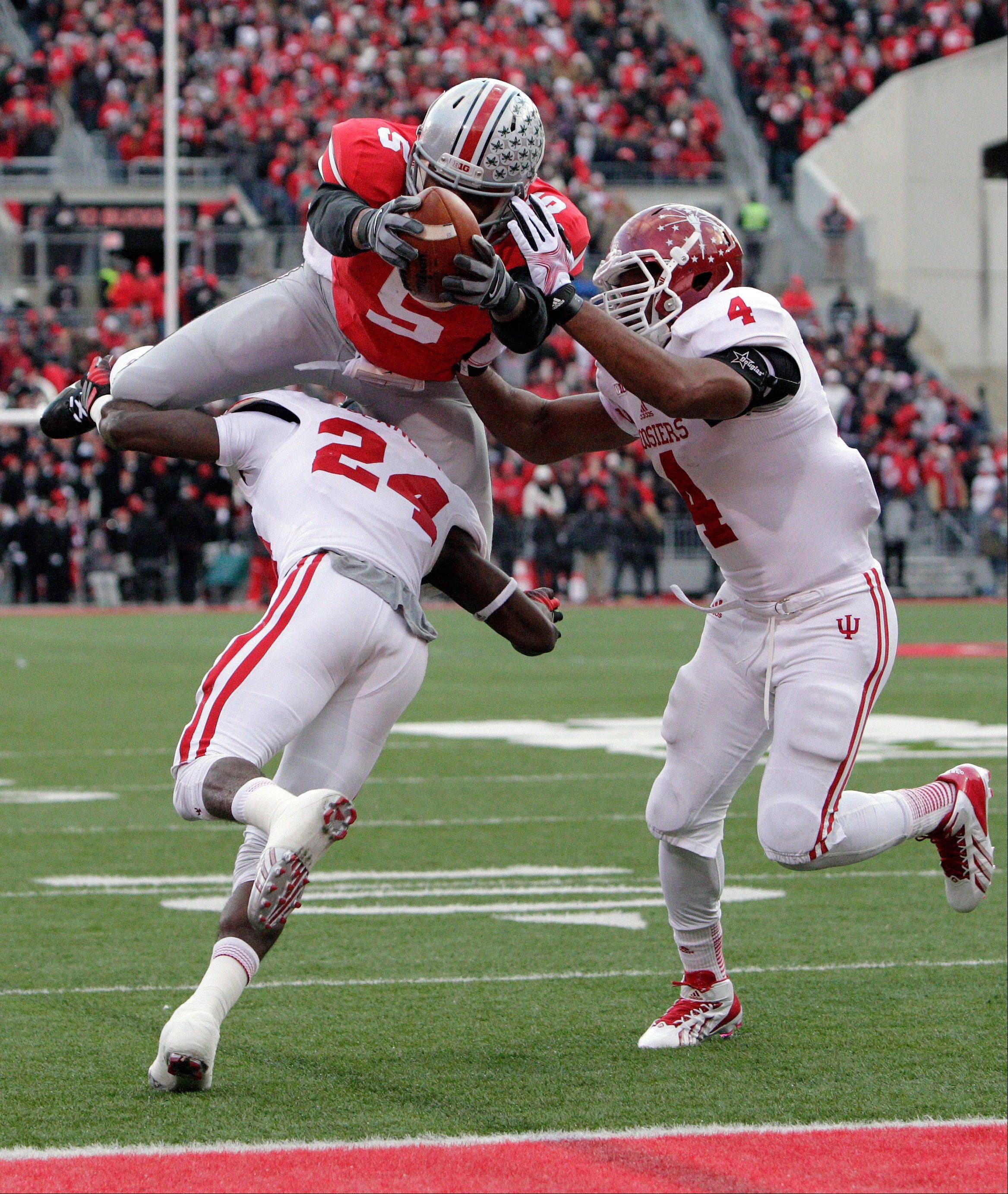Ohio State quarterback Braxton Miller, top, scores a touchdown against Indiana�s Tim Bennett, left, and Forisse Hardin during the second quarter of Saturday�s game in Columbus, Ohio.