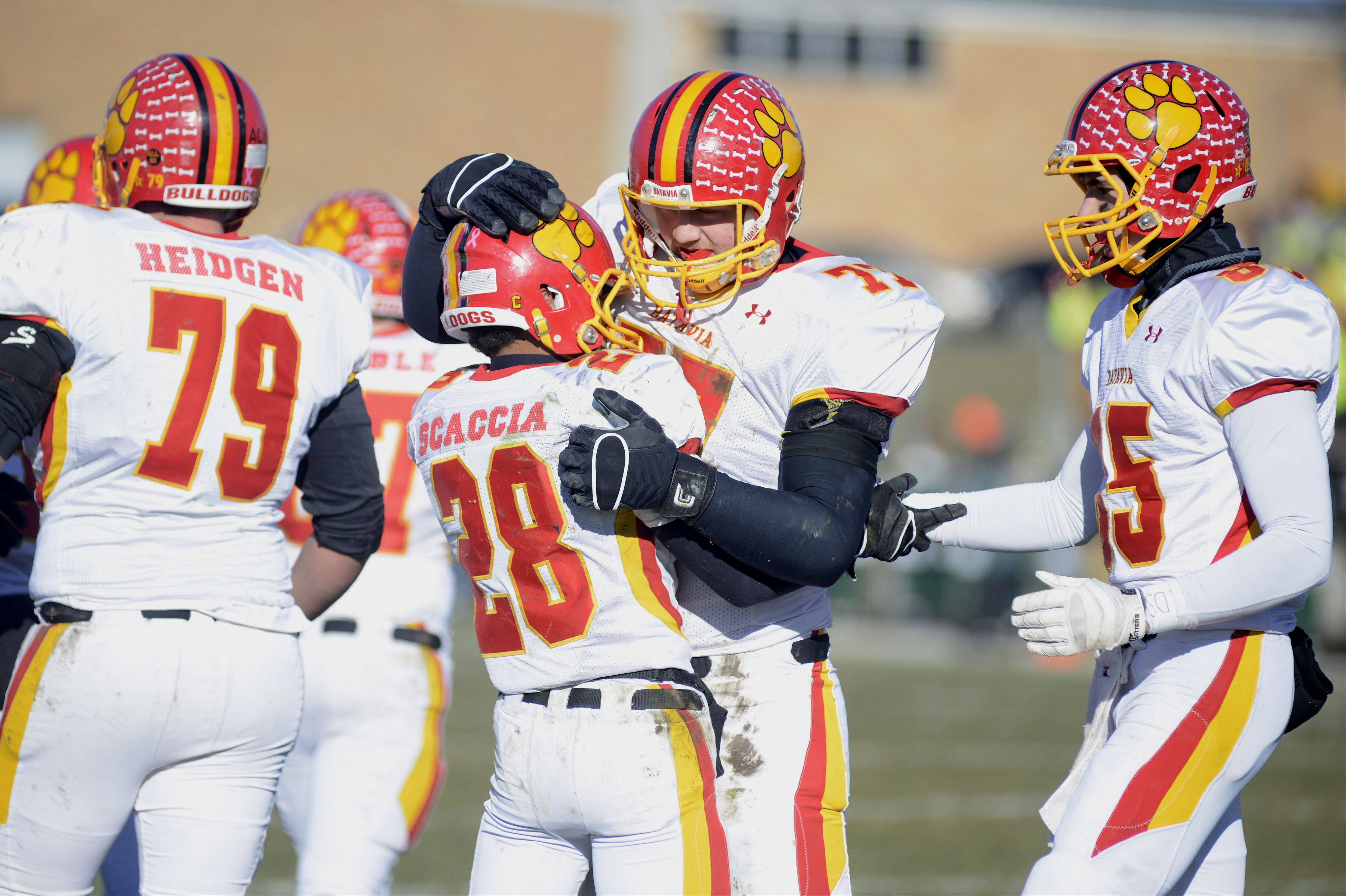 Batavia�s Anthony Scaccia is congratulated by teammates Jack Breshears (77) and Jordan Zwart after scoring a touchdown in the second quarter of the Class 6A semifinal game on Saturday, November 23.