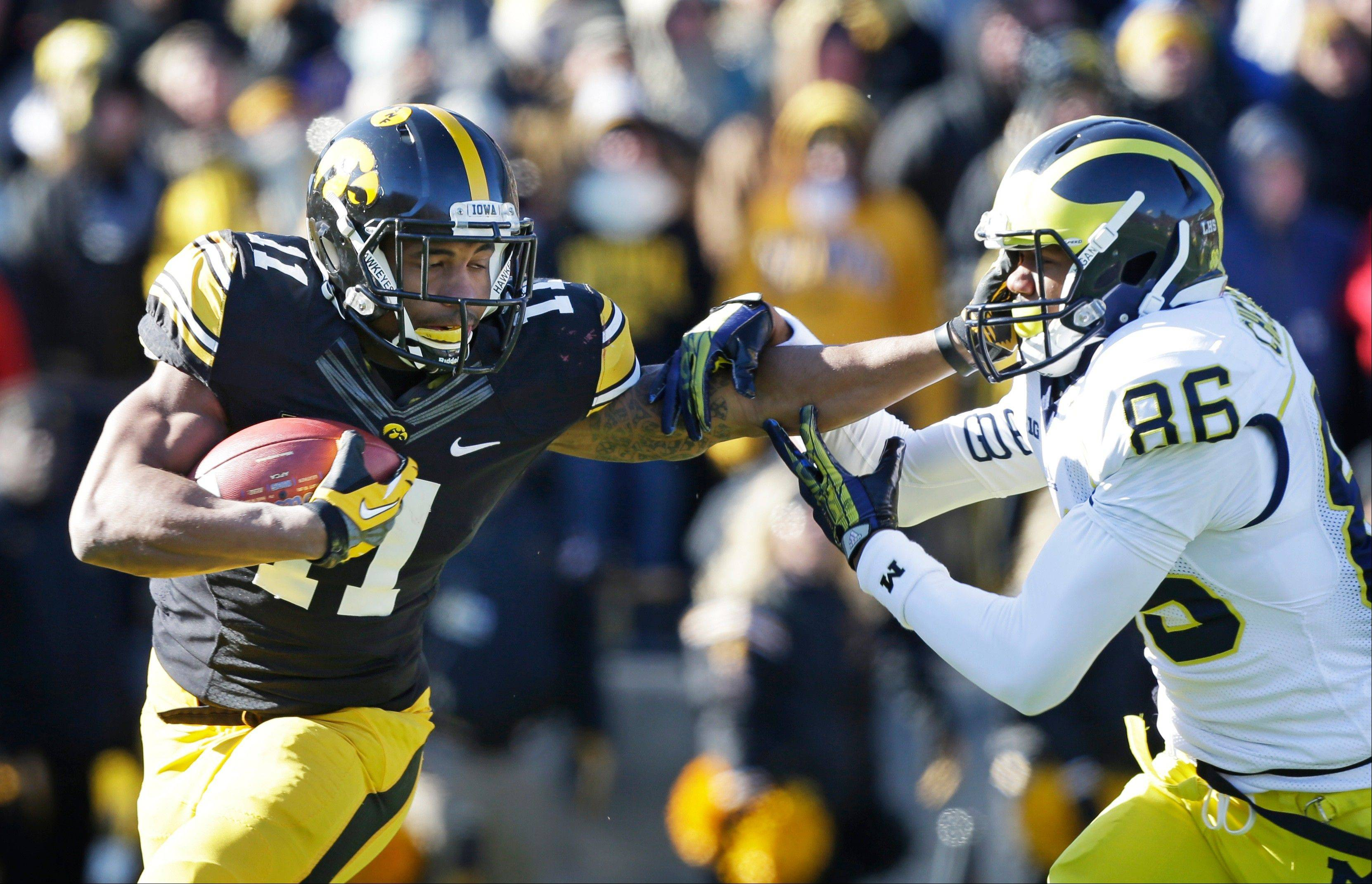 Iowa rallies past Michigan 24-21