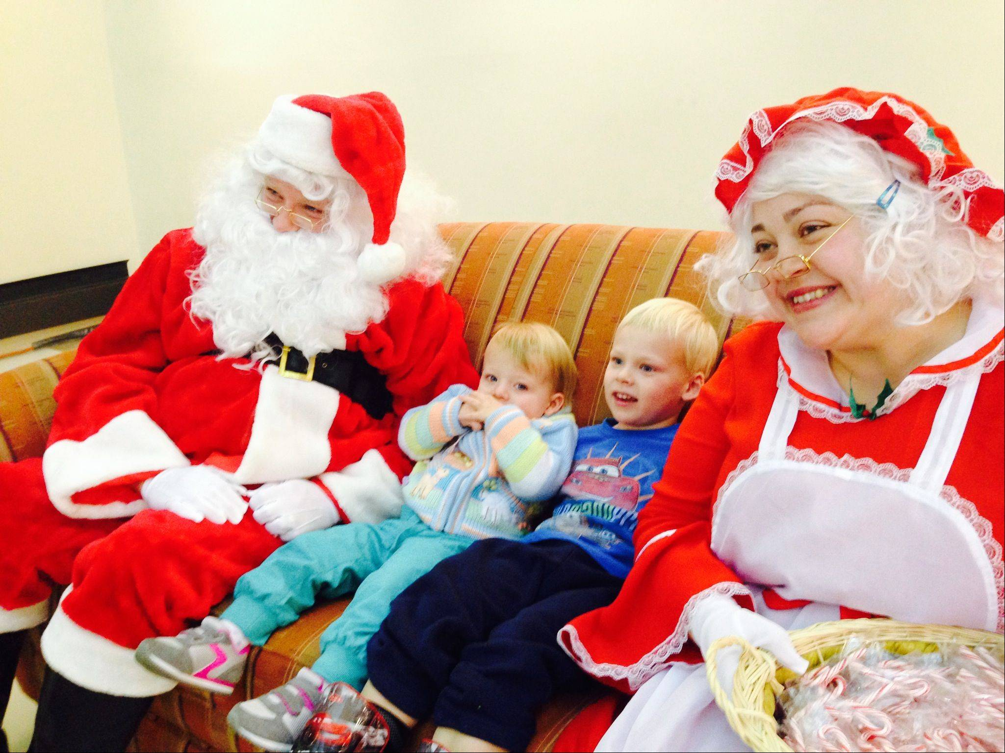 Henry Parks, 3, and his little sister Hailey, 1�, of Cary, met Santa and Mrs. Claus at the Hoffman Estates village hall on Saturday.