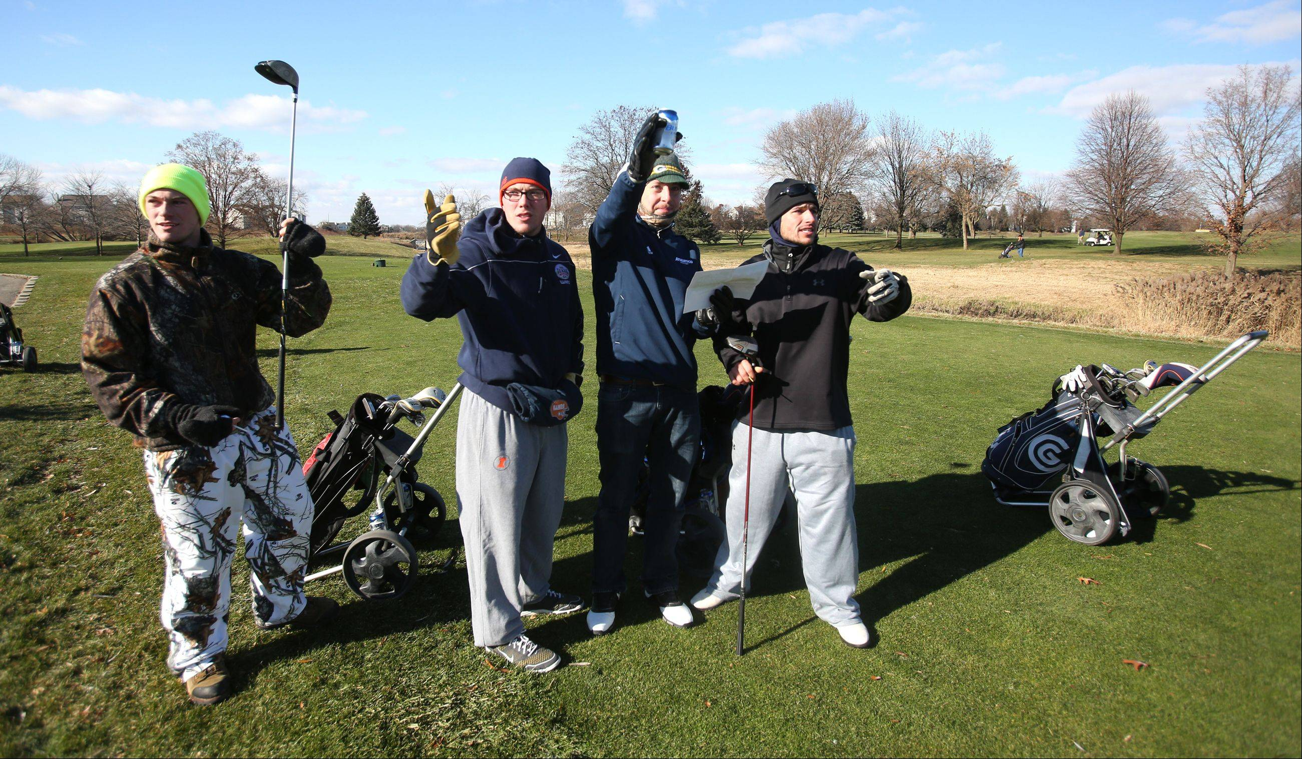 Derek Weber and Zach Pedersen of Joliet, along with Dan Hamburger and Matt Weber of Naperville, survey their next hole during the Naperville Park District's Turkey Shoot golf tournament Saturday at Springbrook Golf Course in Naperville.