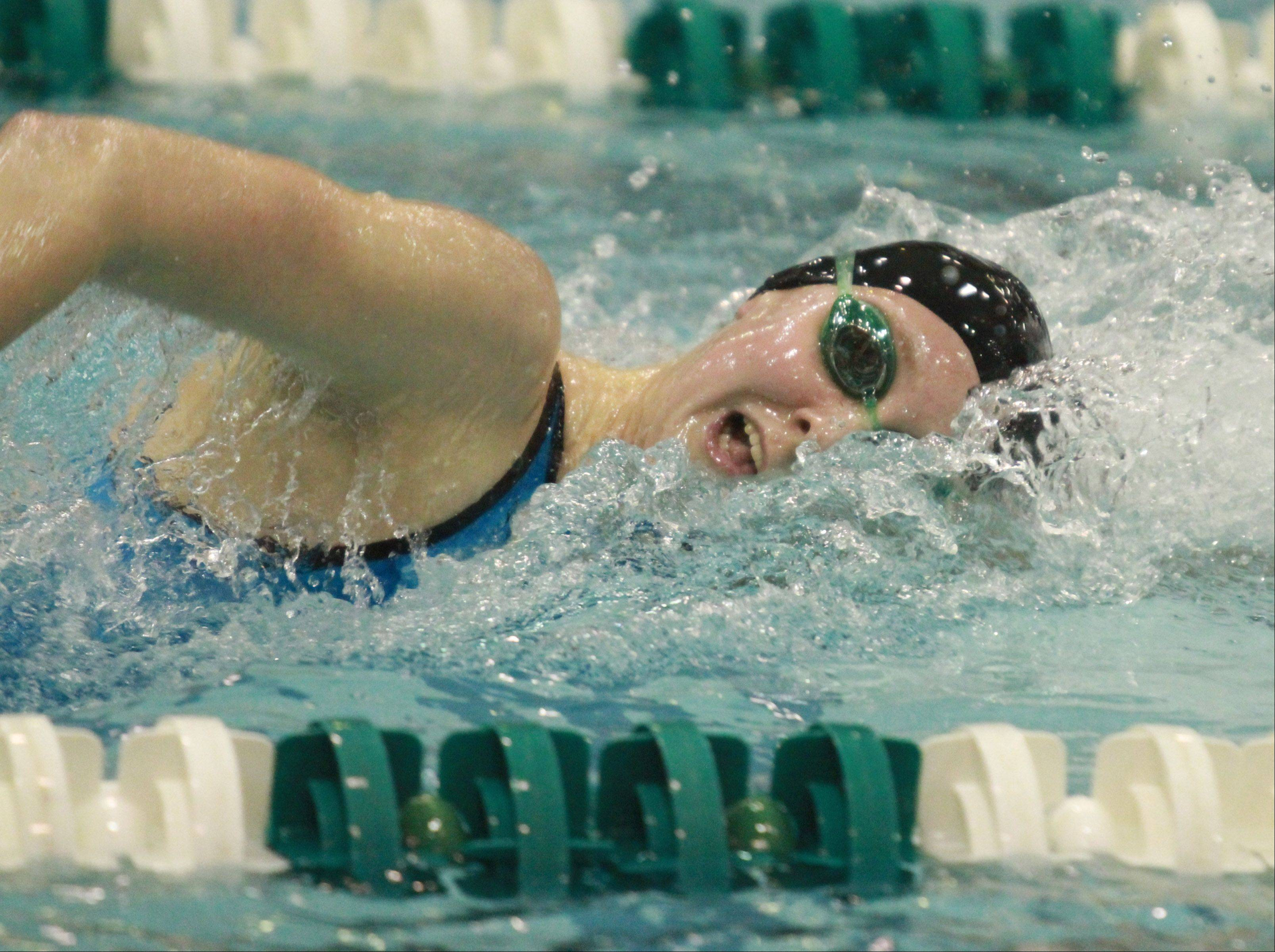 Barrington's Kristen Jacobsen heads for a repeat victory in the 500-yard freestyle in girls swimming state finals on Saturday at New Trier.