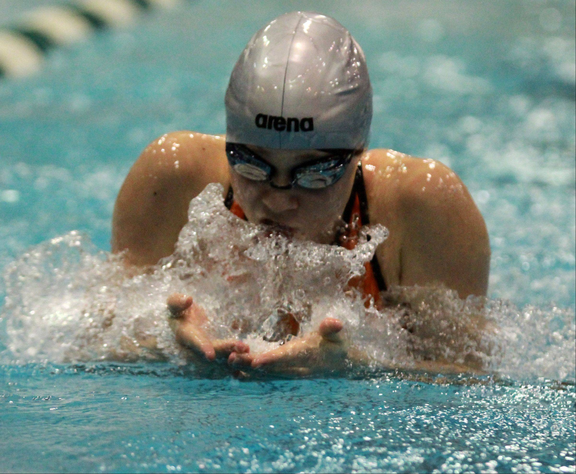 Libertyville's Macey Neubauer swims the second leg of the 200 medley relay at the girls swimming state finals on Saturday at New Trier, where the team placed ninth.