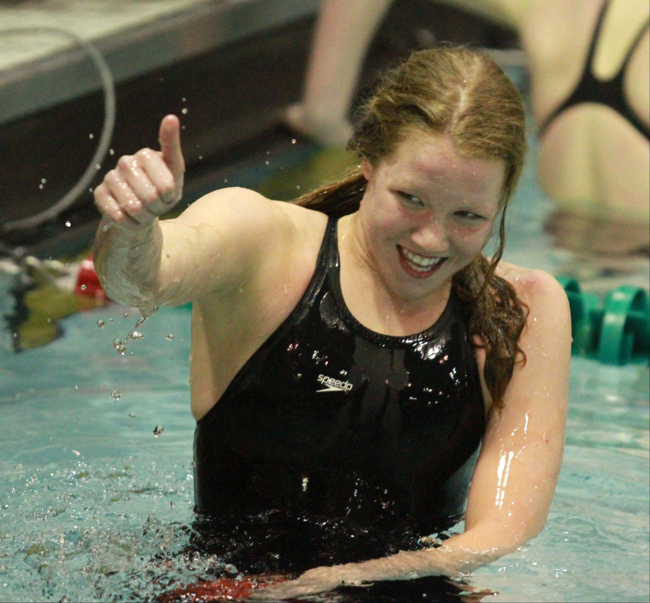 George LeClaire/gleclaire@dailyherald.comMundelein's Erin Falconer celebrates after placing second in the 100-yard freestyle at the girls swimming state finals on Saturday at New Trier.