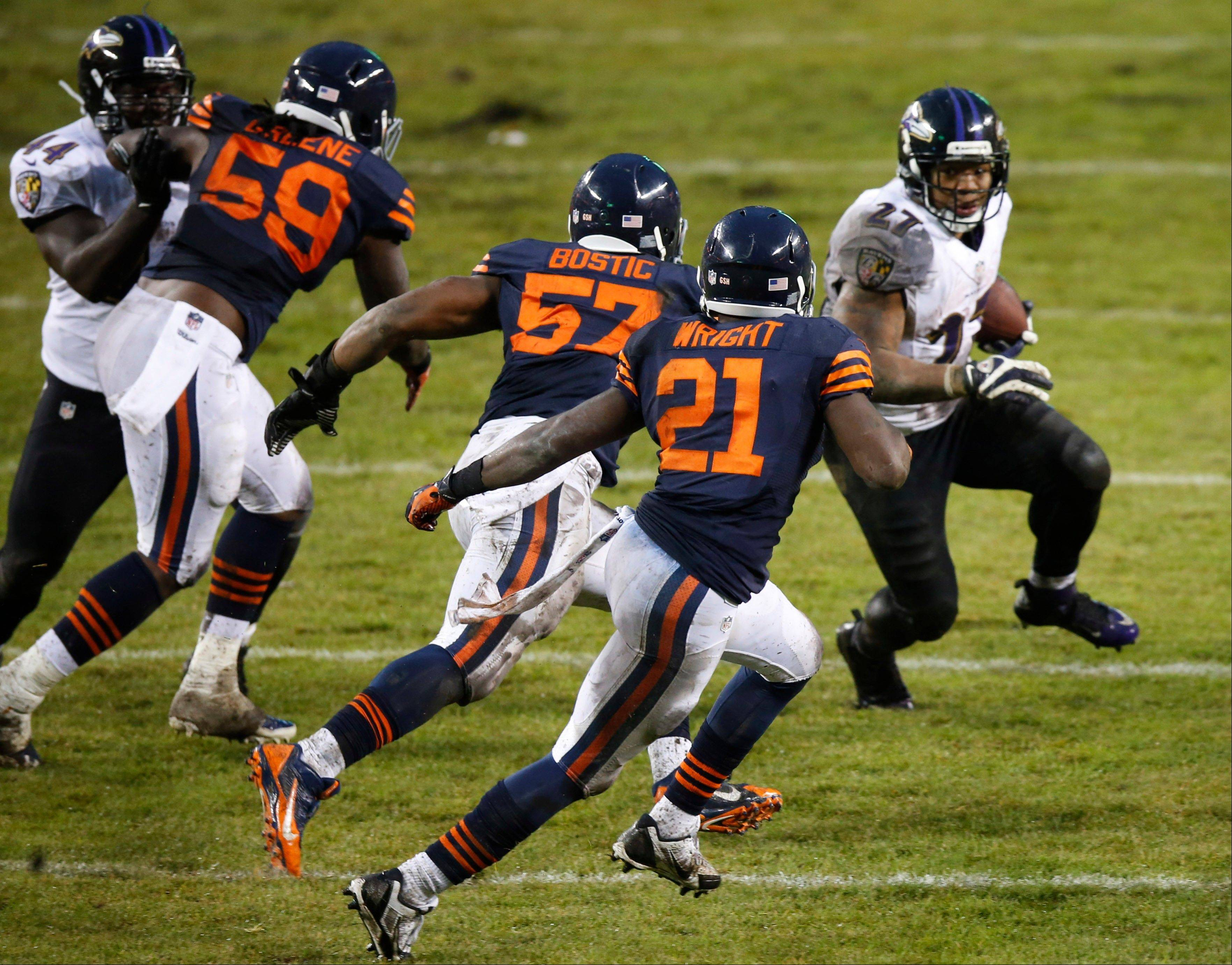 Baltimore running back Ray Rice rushes against Bears safety Major Wright (21), linebacker Jon Bostic (57) and linebacker Khaseem Greene (59) during the second half of last Sunday's game in Chicago. Rice amassed a season-best 131 yards on 25 carries for a 5.2-yard average.