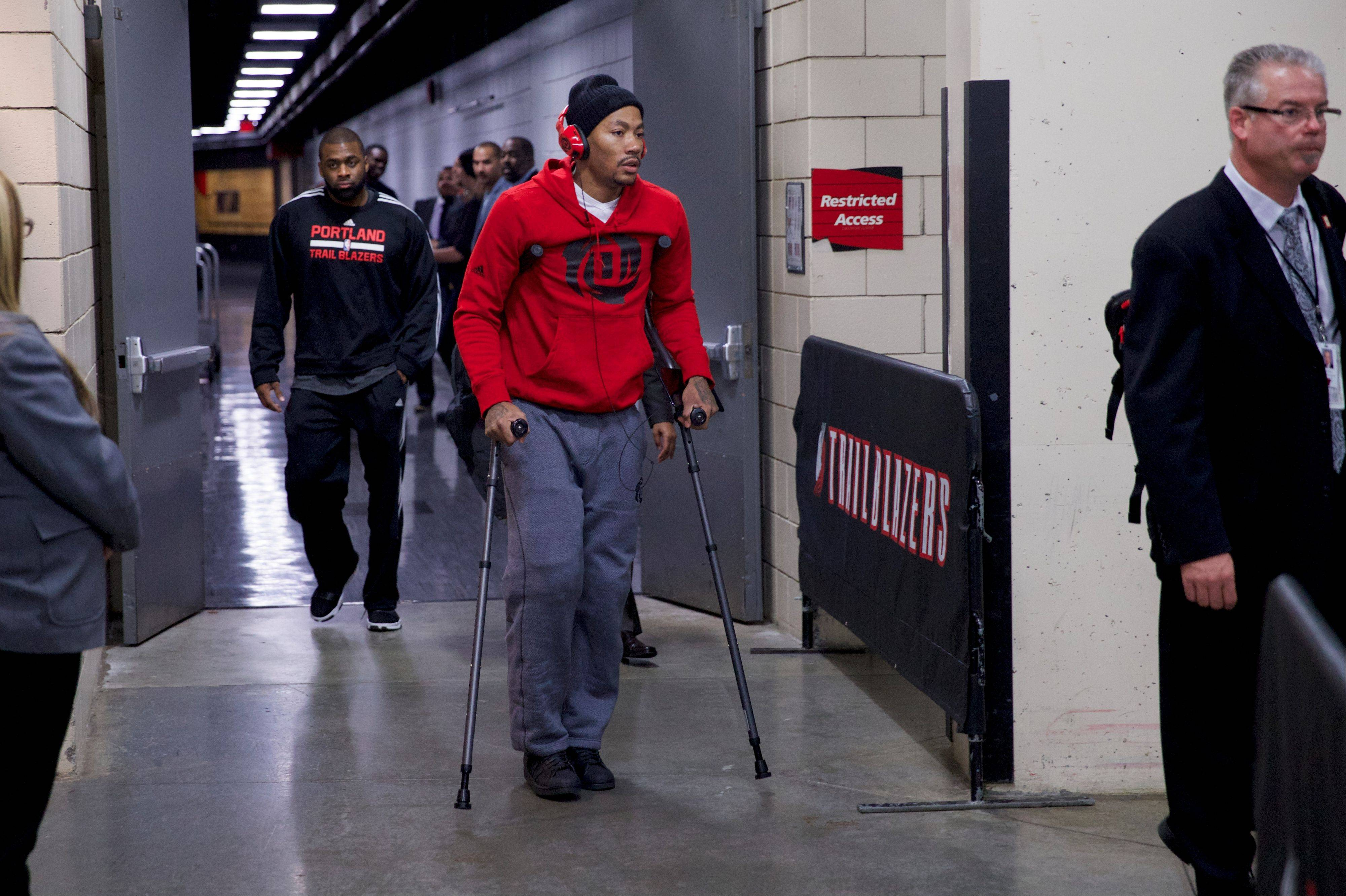 In this photo taken on Friday, Nov. 22, 2013, Bulls point guard Derrick Rose (1) leaves the Moda Center on crutches after he was injured against the Portland Trail Blazers in Portland, Ore. Rose tore meniscus in his right knee and is out indefinitely.
