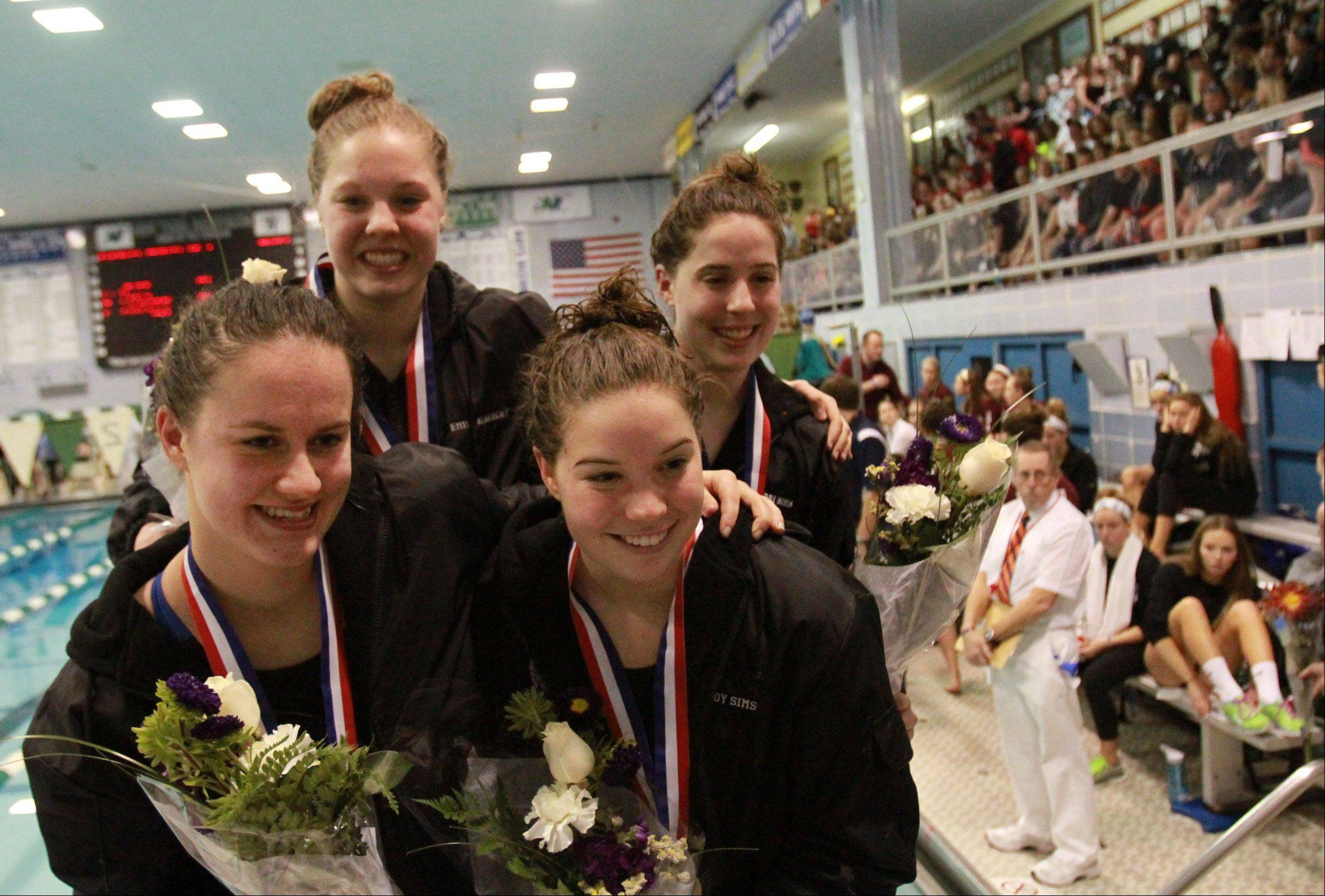 Downers Grove Gabby Sims, Gabriele, Maddy Sims, and Emily Albrecht placed first in 200 medley relay at the girls state swimming finals on Saturday in Winnetka.