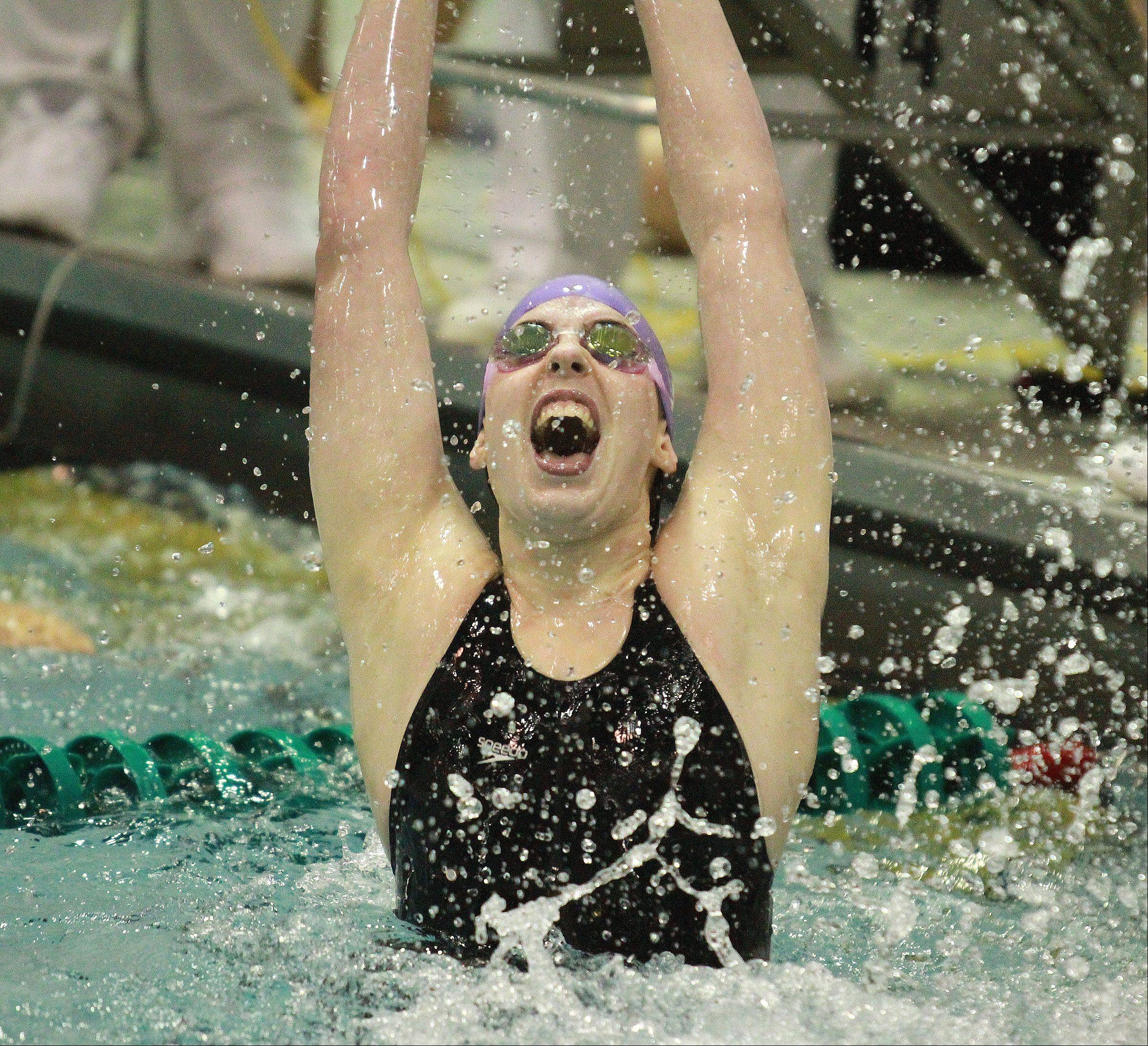 Downers Grove North's Gabby Sims celebrates after swimming the last leg of the 400 yard free style relay and taking 2nd place in the event at the girls state swimming finals on Saturday in Winnetka.