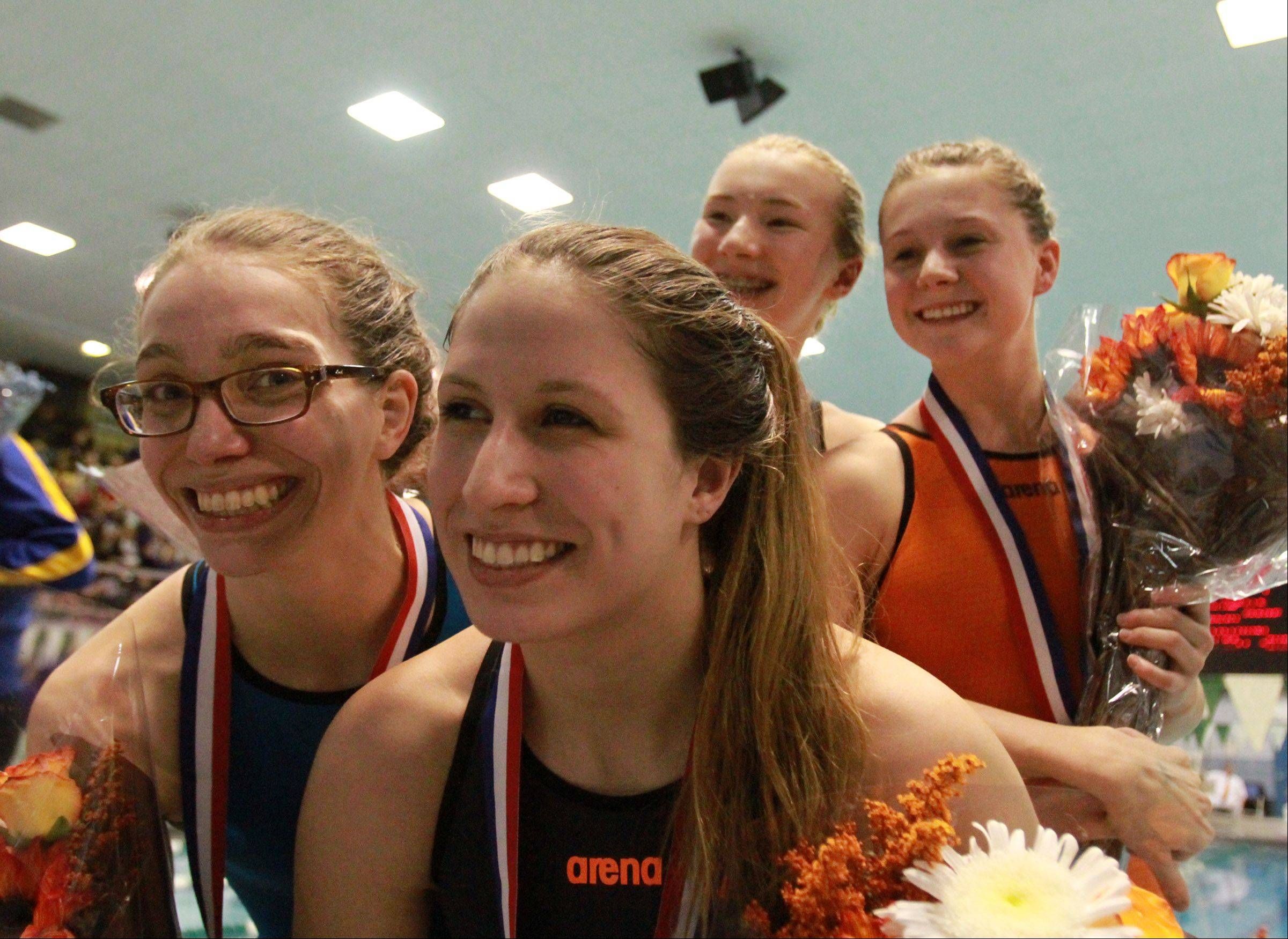 Libertyville's Meredith Robbins, Staci Herchenbach, Sophia Lex, and Macey Neubauer placed ninth in 200 medley relay at the girls state swimming finals on Saturday in Winnetka.