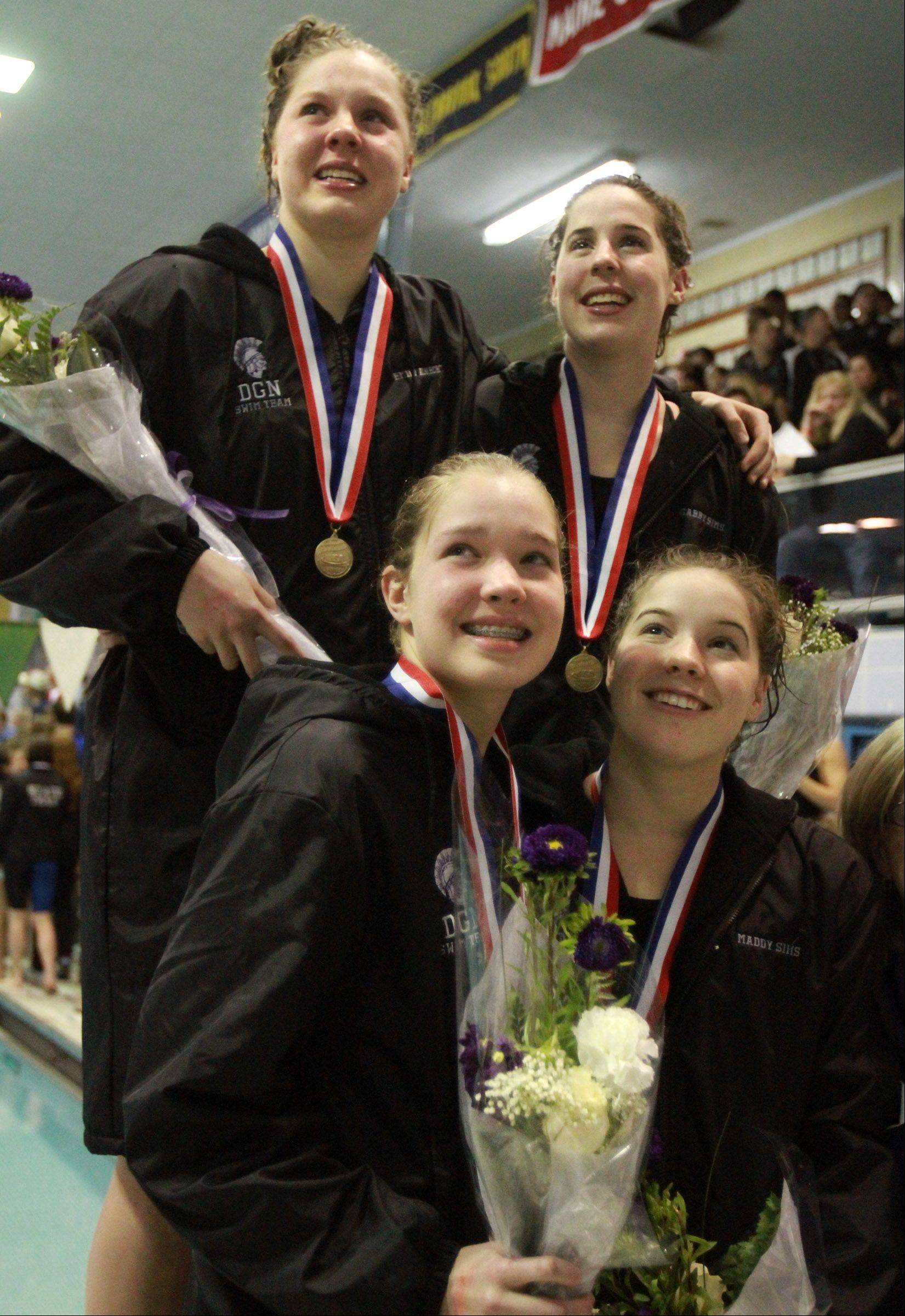 Downers Grove North's Emily Albrecht, Lindsay Mathys, Maddy Sims and Gabby Sims with their medals for 2nd place in the 400 yard free style relay at the girls state swimming finals on Saturday in Winnetka.