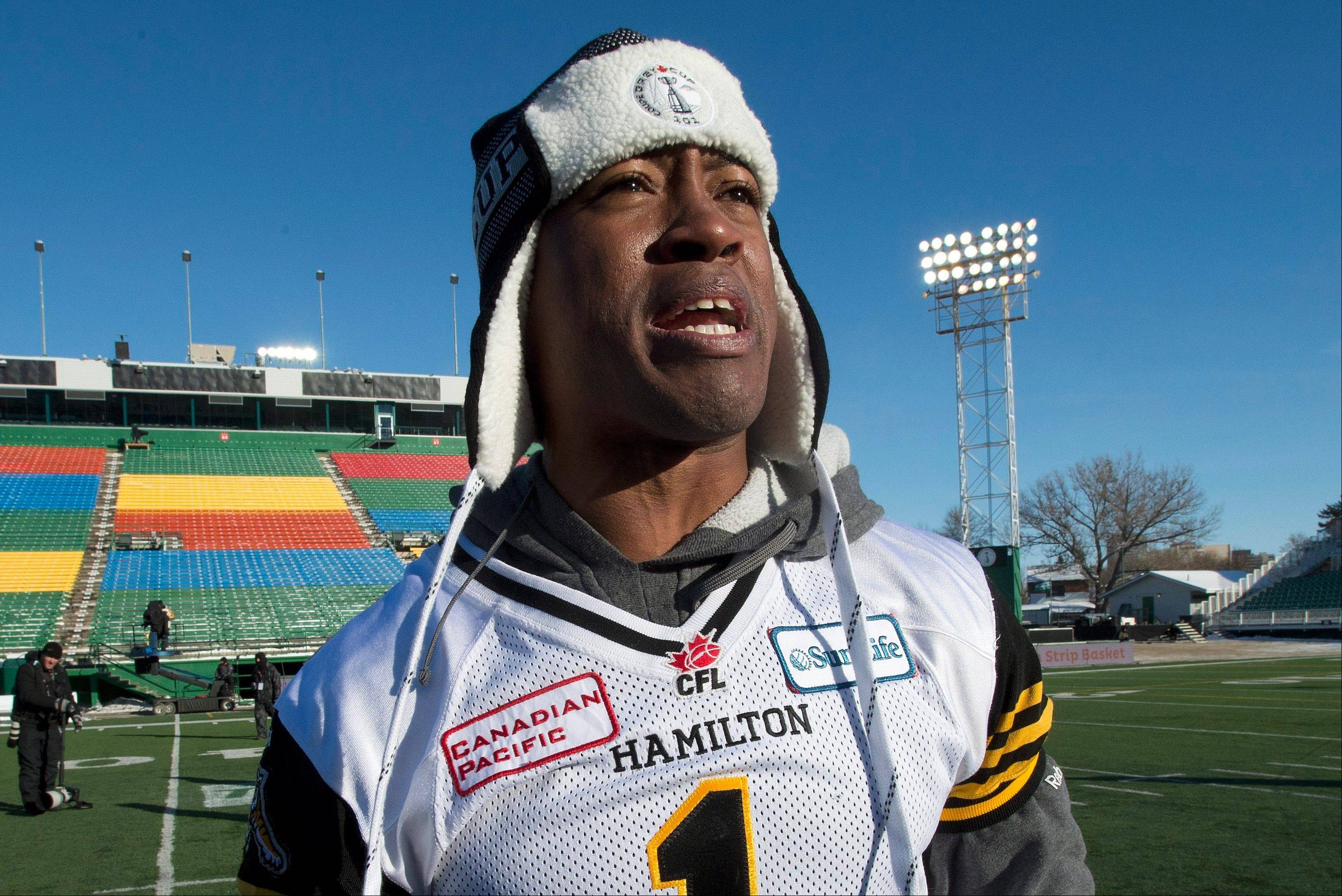 Canadian Football League's Hamilton Tiger-Cats quarterback Henry Burris, who once played for the Chicago Bears, cheers teammates during their practice Saturday. The Saskatchewan Roughriders play the Hamilton Tiger-Cats in the 101st Grey Cup on Sunday.