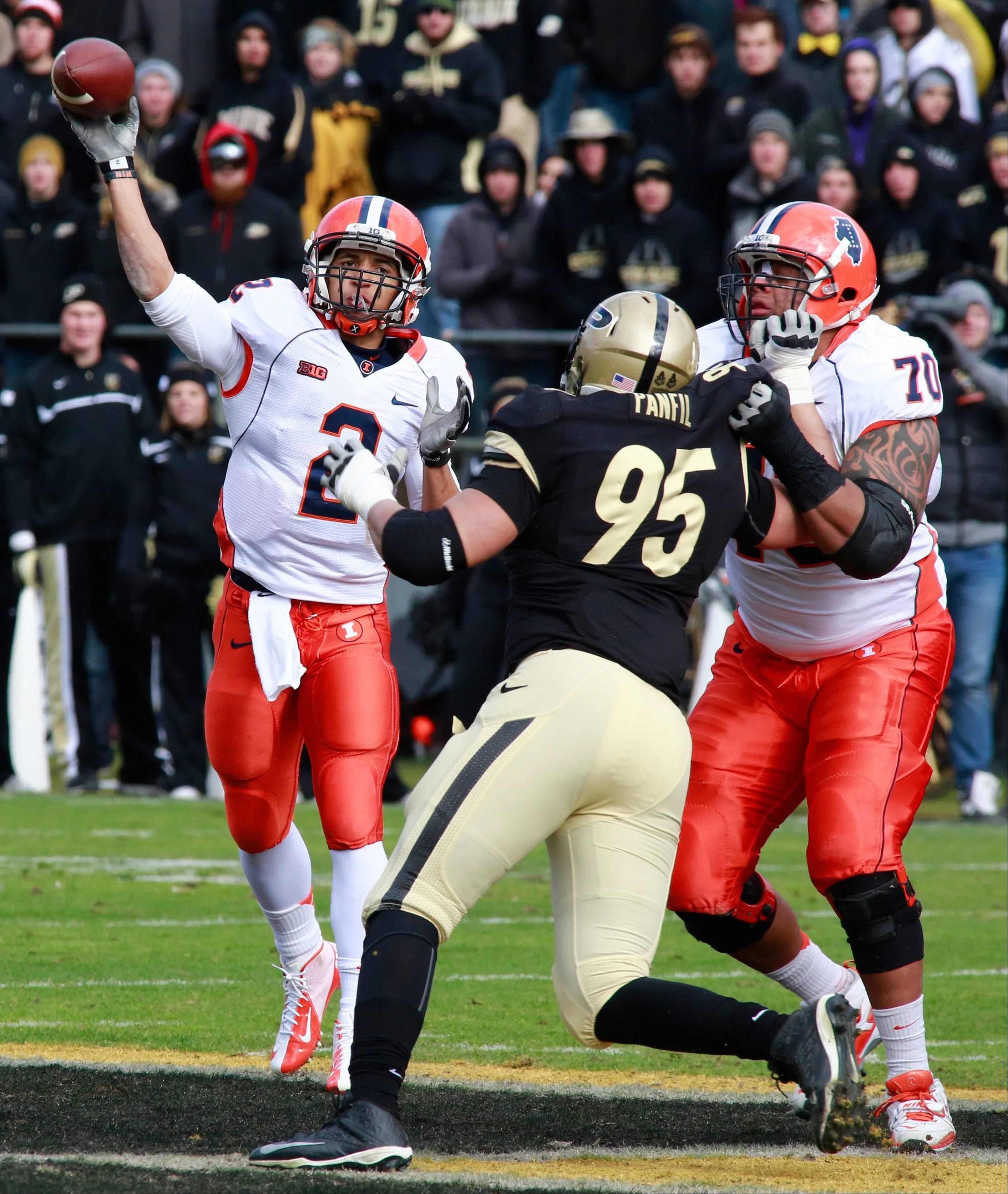 Illinois quarterback Nathan Scheelhaase, left, throws a pass as offensive lineman Corey Lewis (70) blocks Purdue defensive end Evan Panfil (95) in the first half Saturday in West Lafayette, Ind..