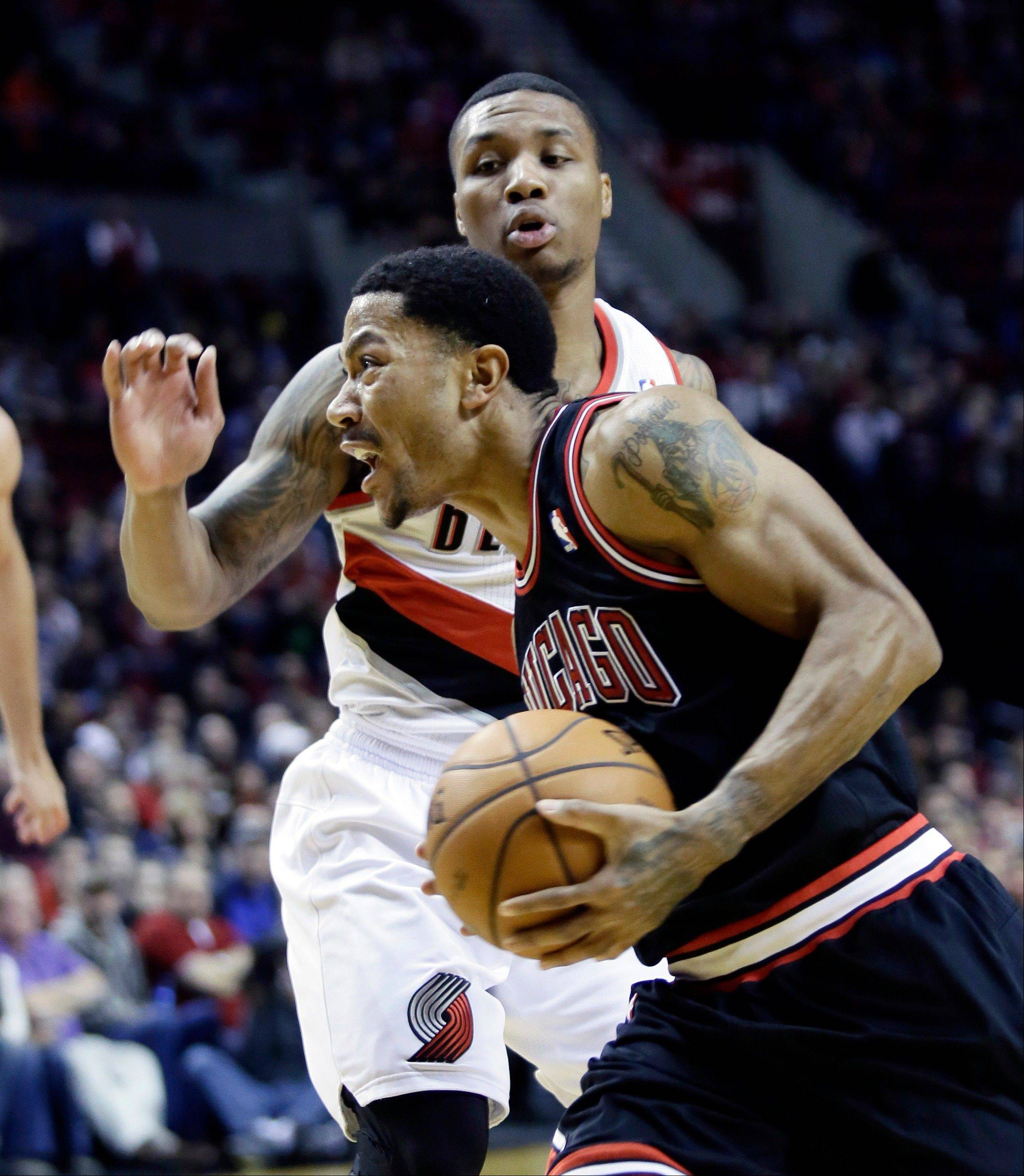 Bulls star Derrick Rose left the game against the Trail Blazers late in the third quarter Friday after injuring his right knee. Rose missed all of last season after having surgery to repair a torn ACL in his left knee.