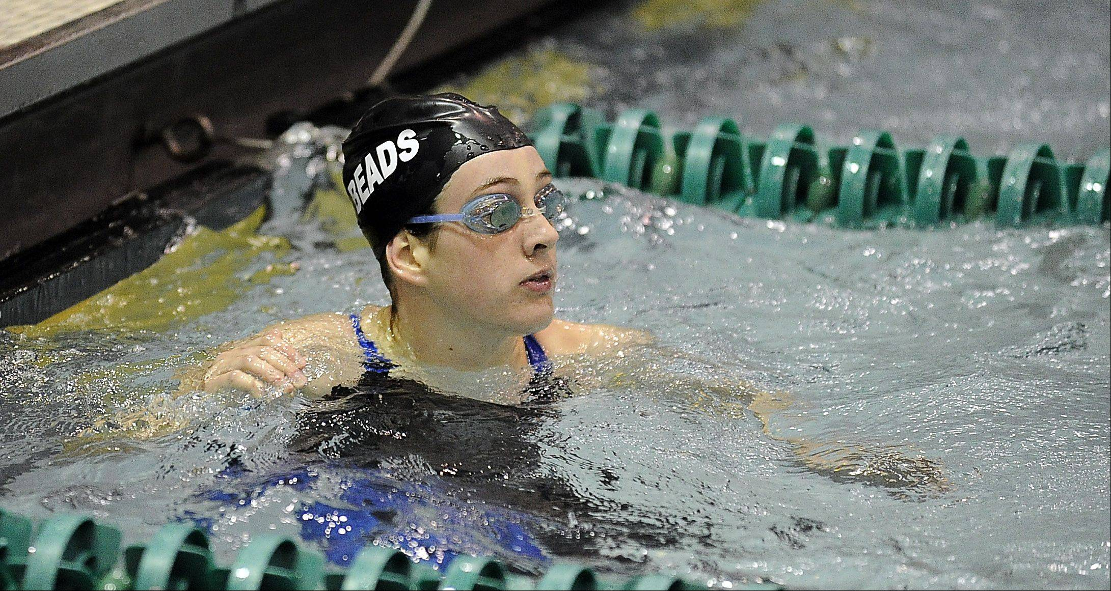 Erin Hart of Rosary looks up to the clock in the 100-yd. individual medley at the girls state finals prelims at New Trier High School on Friday.