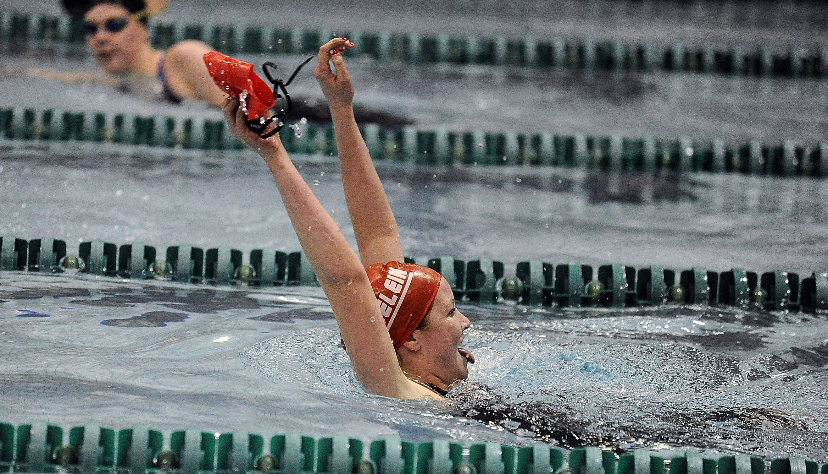Mundelein's Erin Falconer celebrates after completing the 200-yd freestyle at the girls state finals prelims at New Trier High School on Friday.
