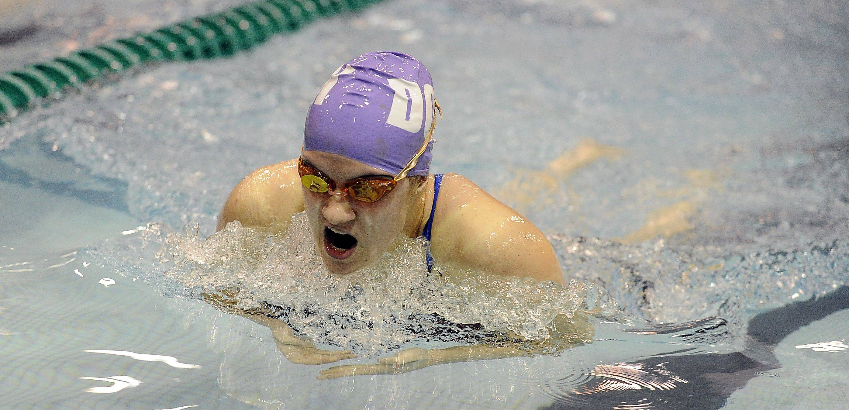Downers Grove North's Gabriele Serniute plows through the water in the 200-yd. individual medley at the girls state finals prelims at New Trier High School on Friday.