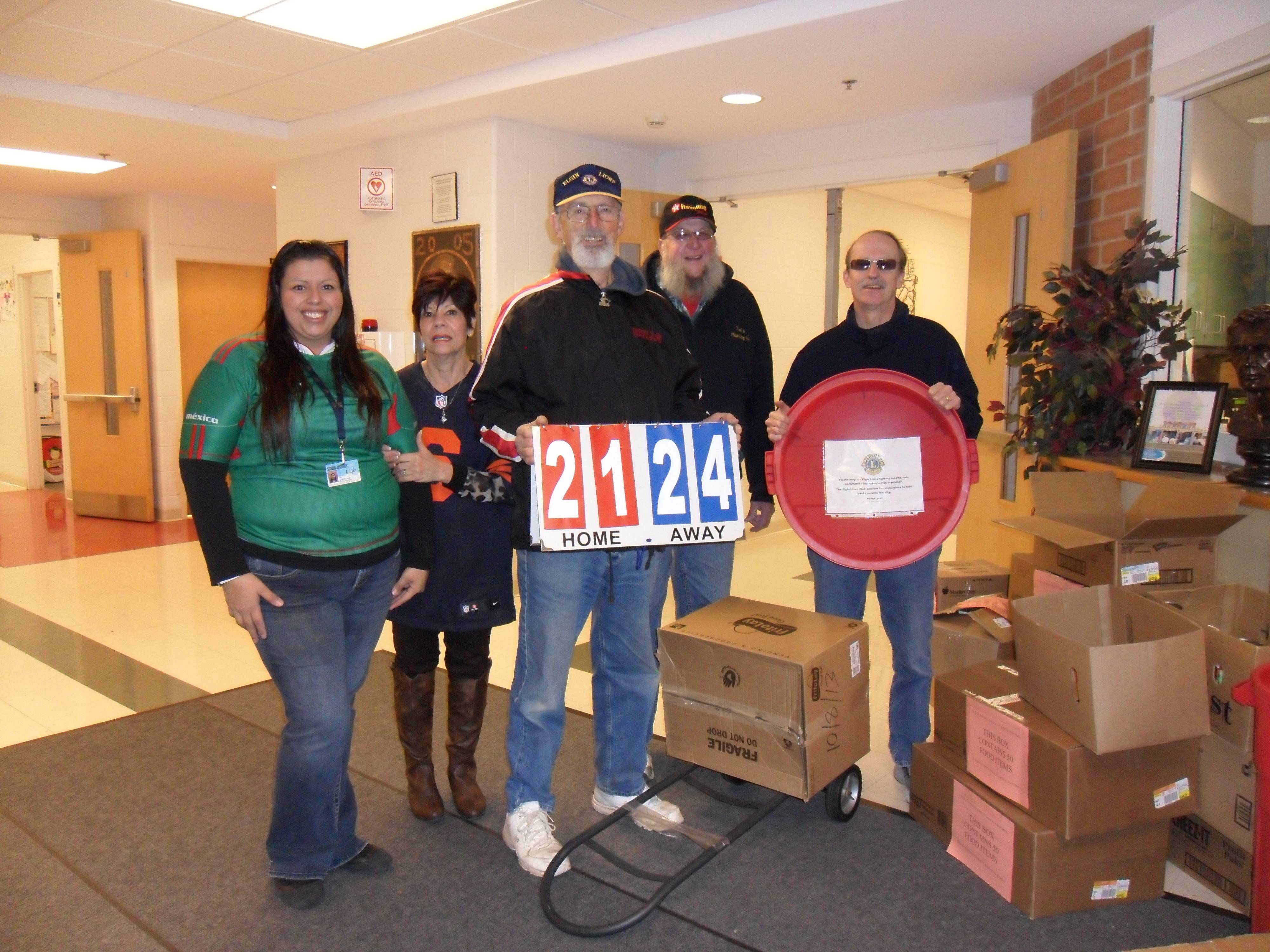 Lincoln Elementary produces record non-perishable food collection of 2,124 items. Pictured from left, Lisa Cardenas, assistant principal, Dr. Mariann Alyea, principal, Jim Beam, Tom Wahl, and Ed Bates. Not pictured, but helping, Karen Peterson, Ken Zehnder and Dick June.
