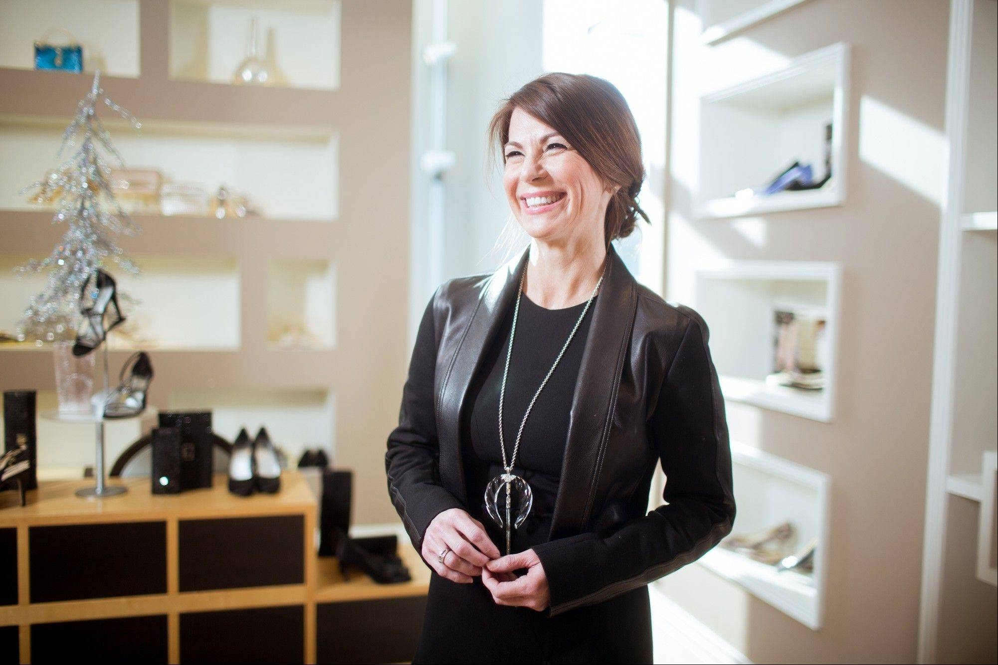 Rebecca Wierda, co-owner and president of Leigh's, an upscale independent clothing retail in Grand Rapids, Mich., poses for a photo. Leigh's plans five parties including one Black Friday and another aimed at men shopping for wives and girlfriends.