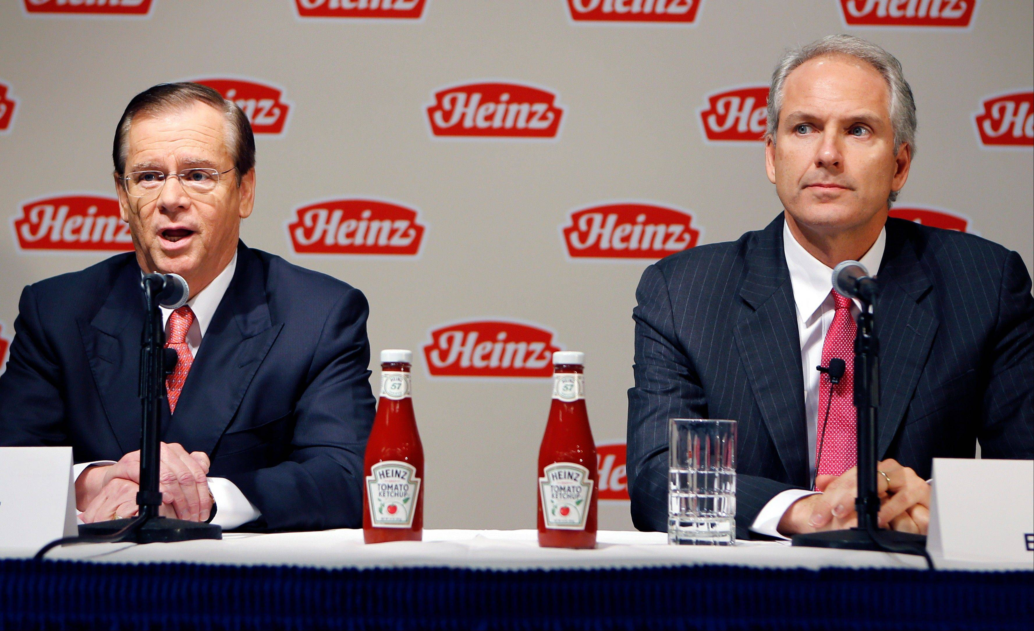 H.J. Heinz Co. CEO William Johnson, left, and 3G Capital Managing Partner, Alex Behring, speak at a news conference at the world headquarters of the H.J. Heinz Co. in Pittsburgh. A sluggish economic recovery, pricey stock evaluations and fears of more gridlock in Washington have stalled deal activity in 2013. Berkshire Hathaway and 3G Capital acquiring Heinz is one of the few big deals this year.