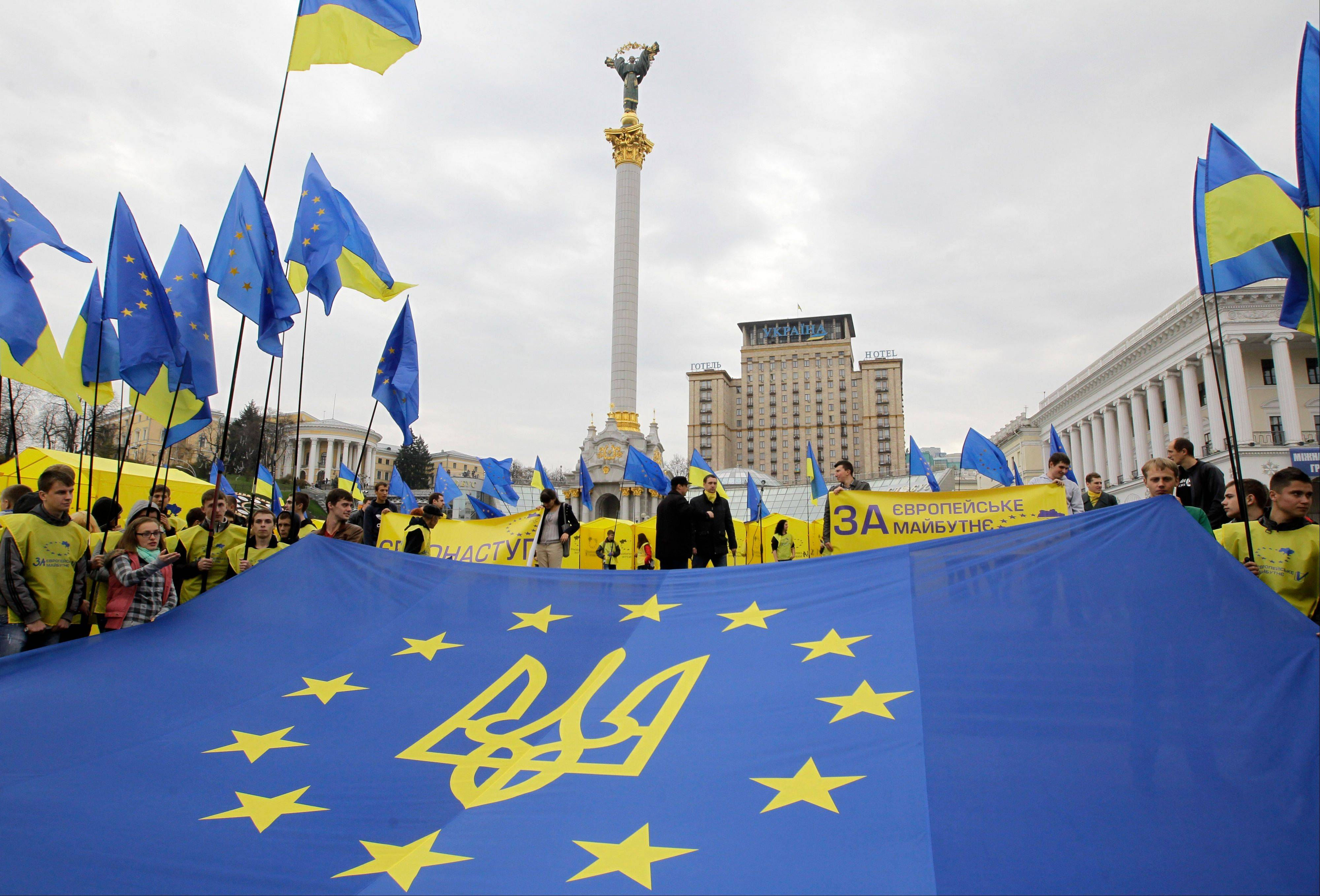 "Activists rally in the center of Kiev, Ukraine, in support of Ukraine's integration with the European Union. More than 20 years after gaining independence from the Soviet Union and painfully searching for its place on the geopolitical map, Ukraine finally has a real chance to firmly align itself with the EU, with its democratic standards and free-market zone. The alternative is to slide back into Russia's shadow, both politically and economically. The slogan reads: ""For the European future."""