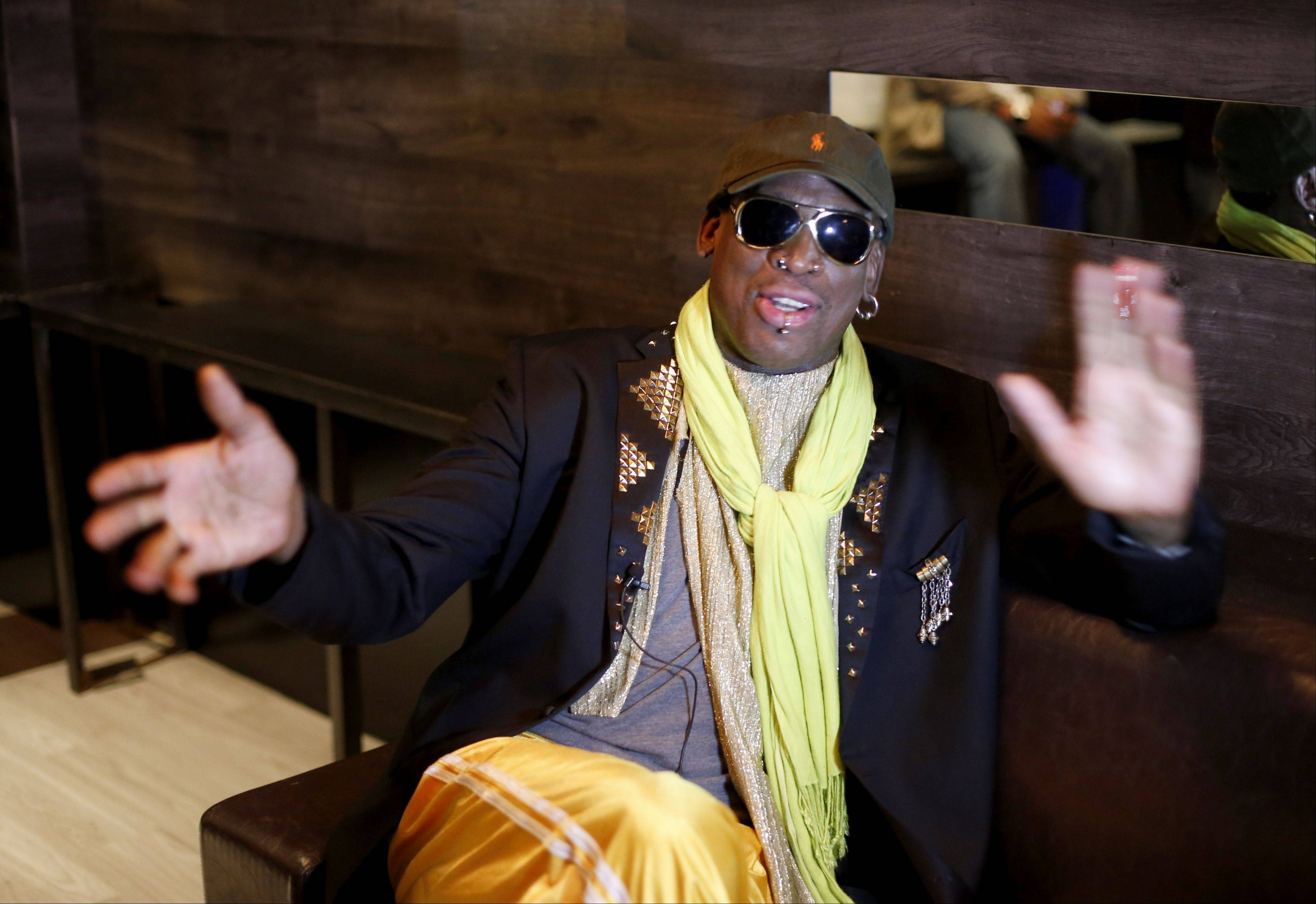 In this Thursday, Nov. 21, 2013 photo, Dennis Rodman gestues during an interview after a promotional event to pitch a vodka brand in Chicago. Rodman has been named GQ's least influential celebrity of 2013.