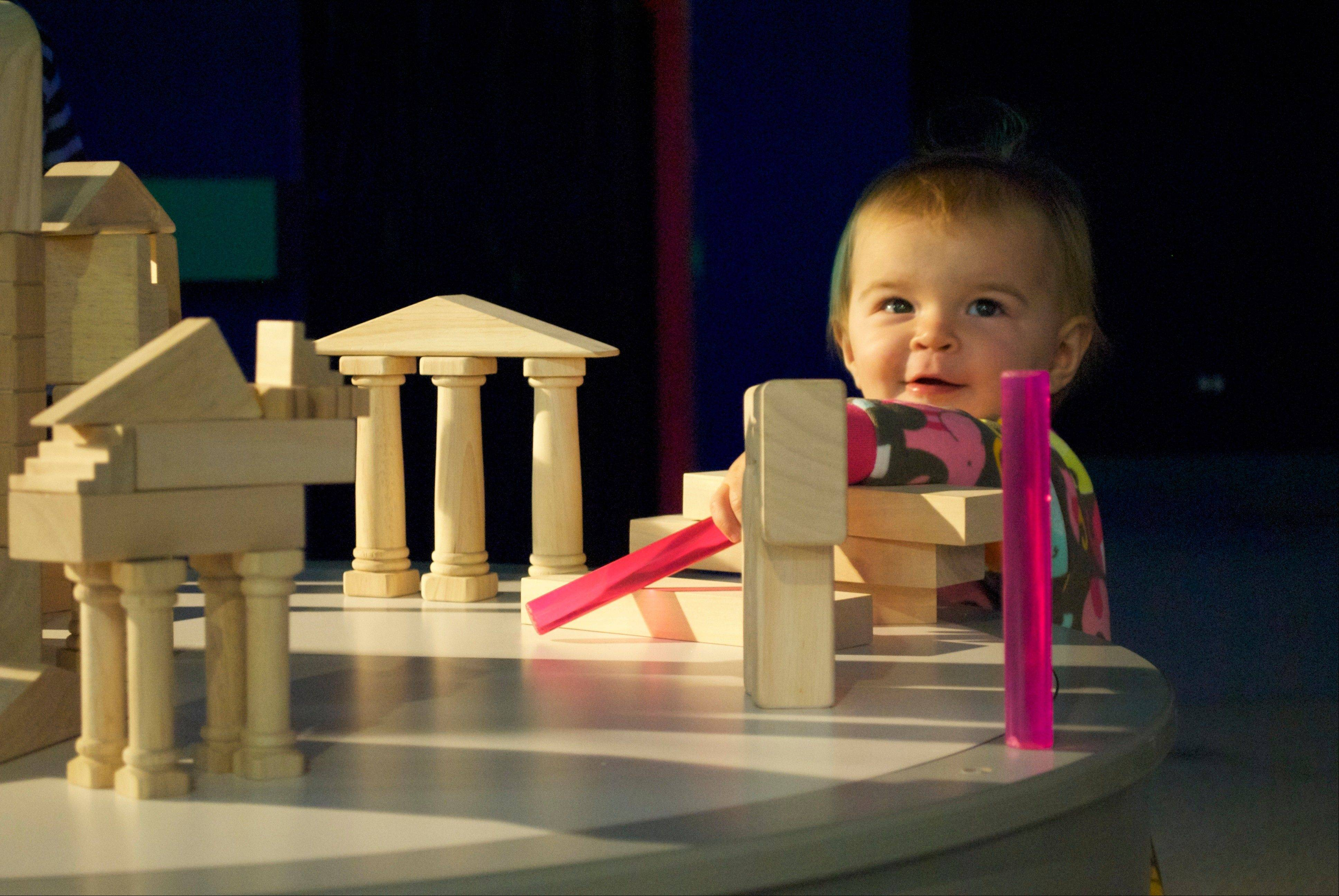 "Young visitors to the ""Monumental"" exhibit at the DuPage Children's Museum can build mini-monuments. They do so in a spot where the light keeps changing, teaching that monuments were often built to take advantage of shadows."