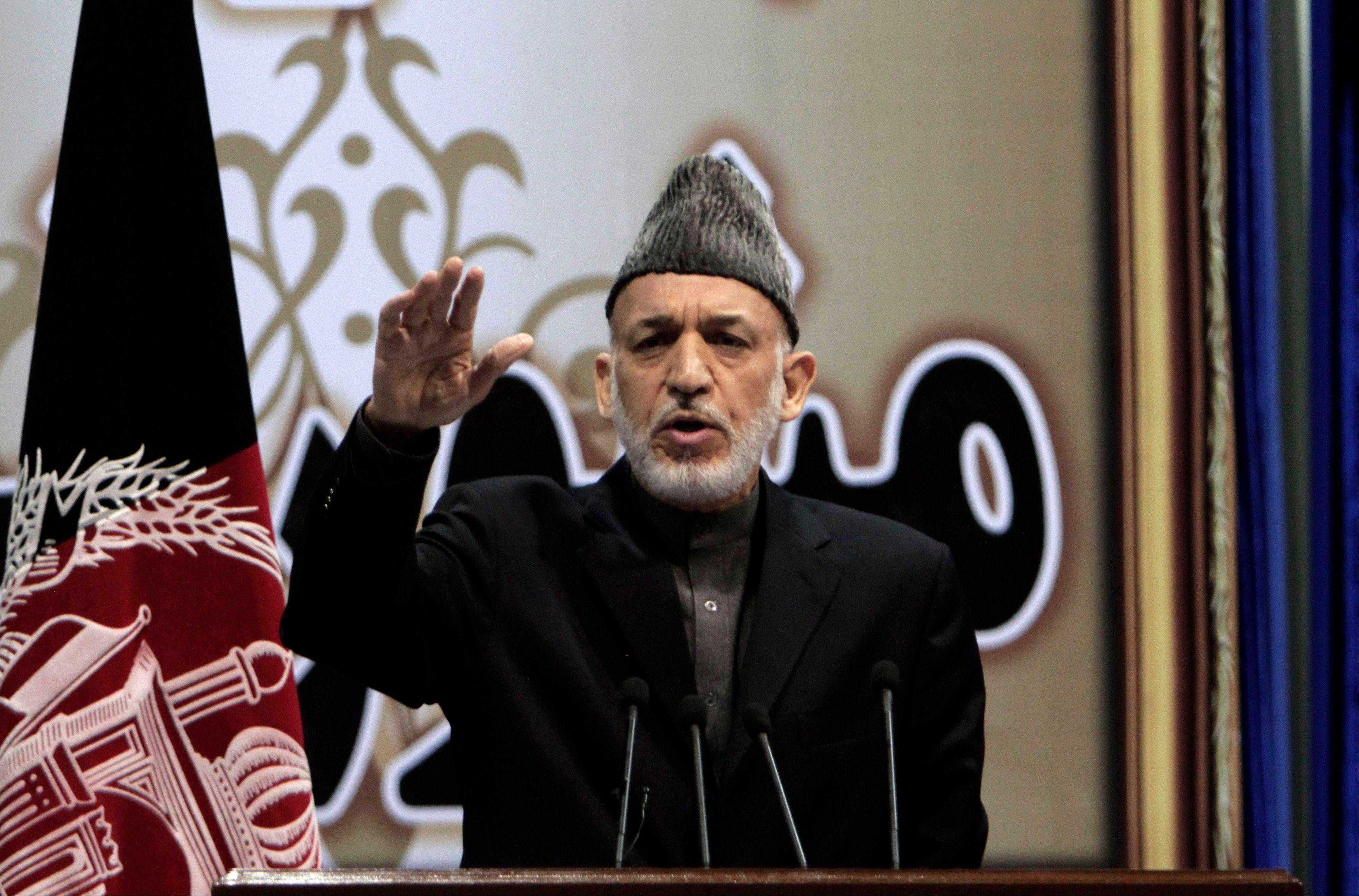 Afghan President Hamid Karzai on Sunday said he won't immediately sign a security deal with the United States, ignoring a recommendation by an assembly of Afghan elders and leaders he do so by the end of the year. He argued Afghanistan needed more time to ensure the U.S. was committed to peace.