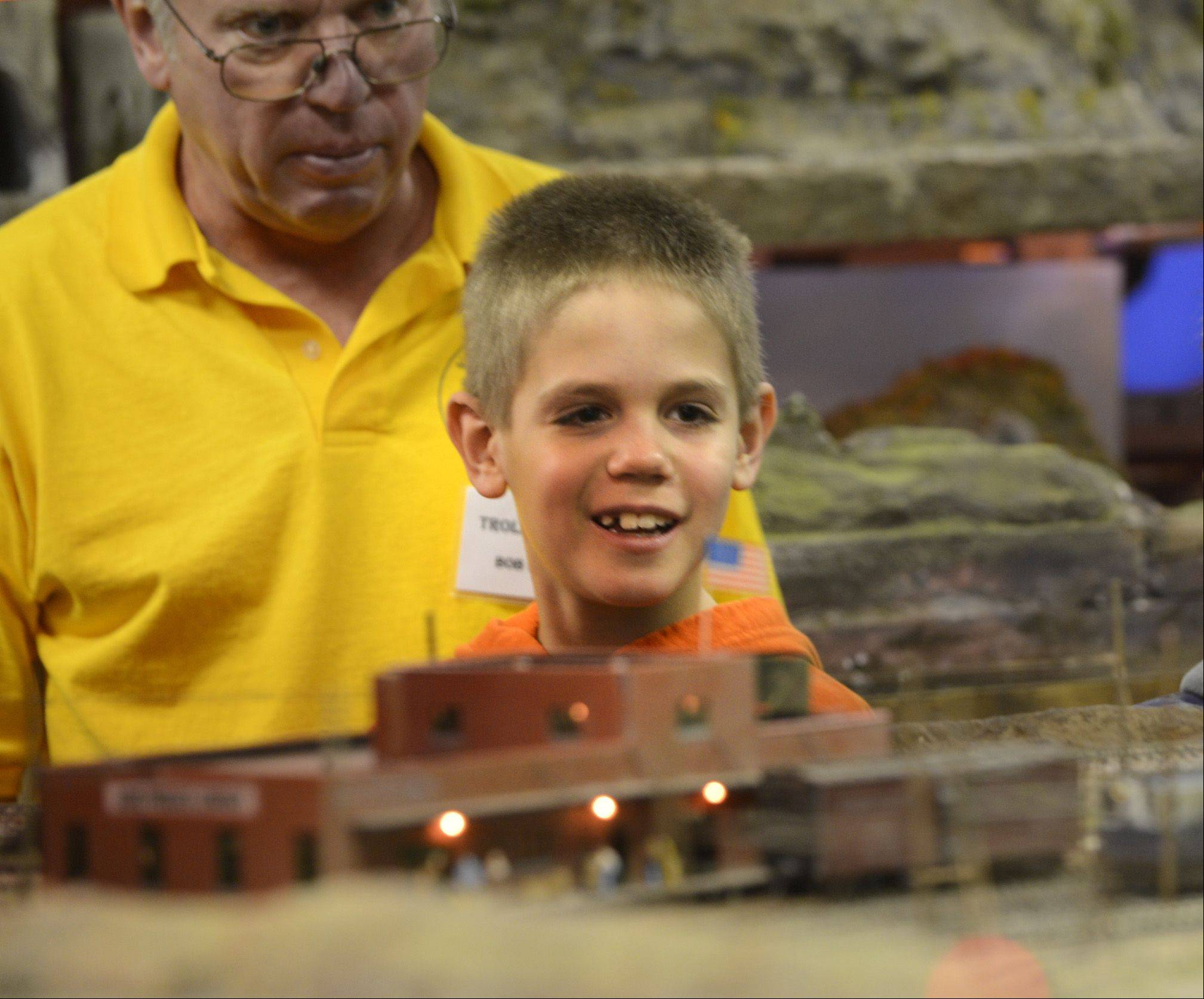 Nathan Sonehocker, 9, of Aurora, watches model trains run on 400 feet of track Sunday at the Valley Model Railroad Club's open house in South Elgin.