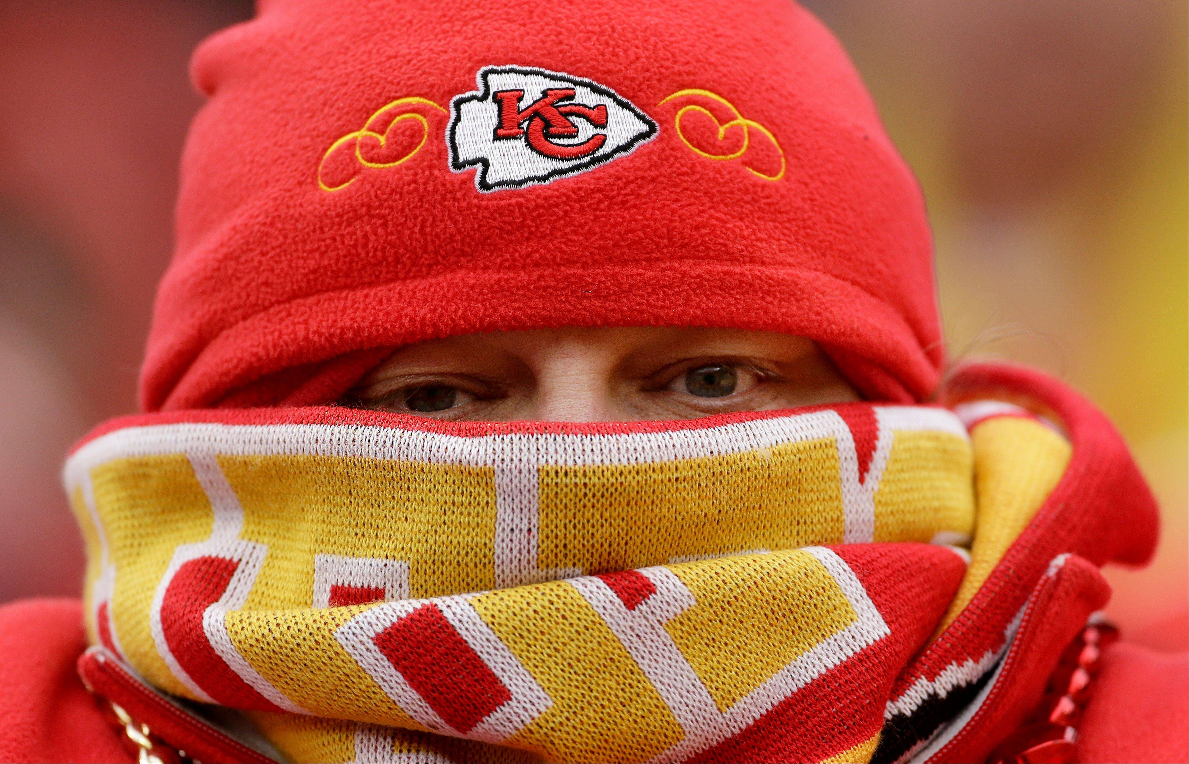 A Kansas City Chiefs fan watches during the final minutes of an NFL football game against the San Diego Chargers on Sunday at Arrowhead Stadium in Kansas City. A cold wave, in many areas accompanied by snow or ice, stretches over the eastern two-thirds of the country and threatens holiday travel.