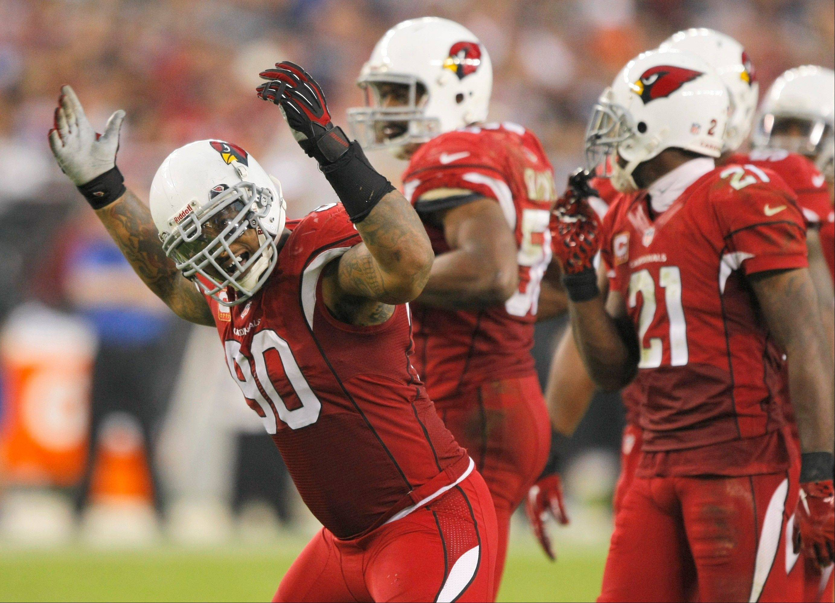 Arizona Cardinals defensive end Darnell Dockett (90) celebrates during the second half of an NFL football game against the Indianapolis Colts, Sunday, Nov. 24, 2013, in Glendale, Ariz. The Cardinals won 40-11.
