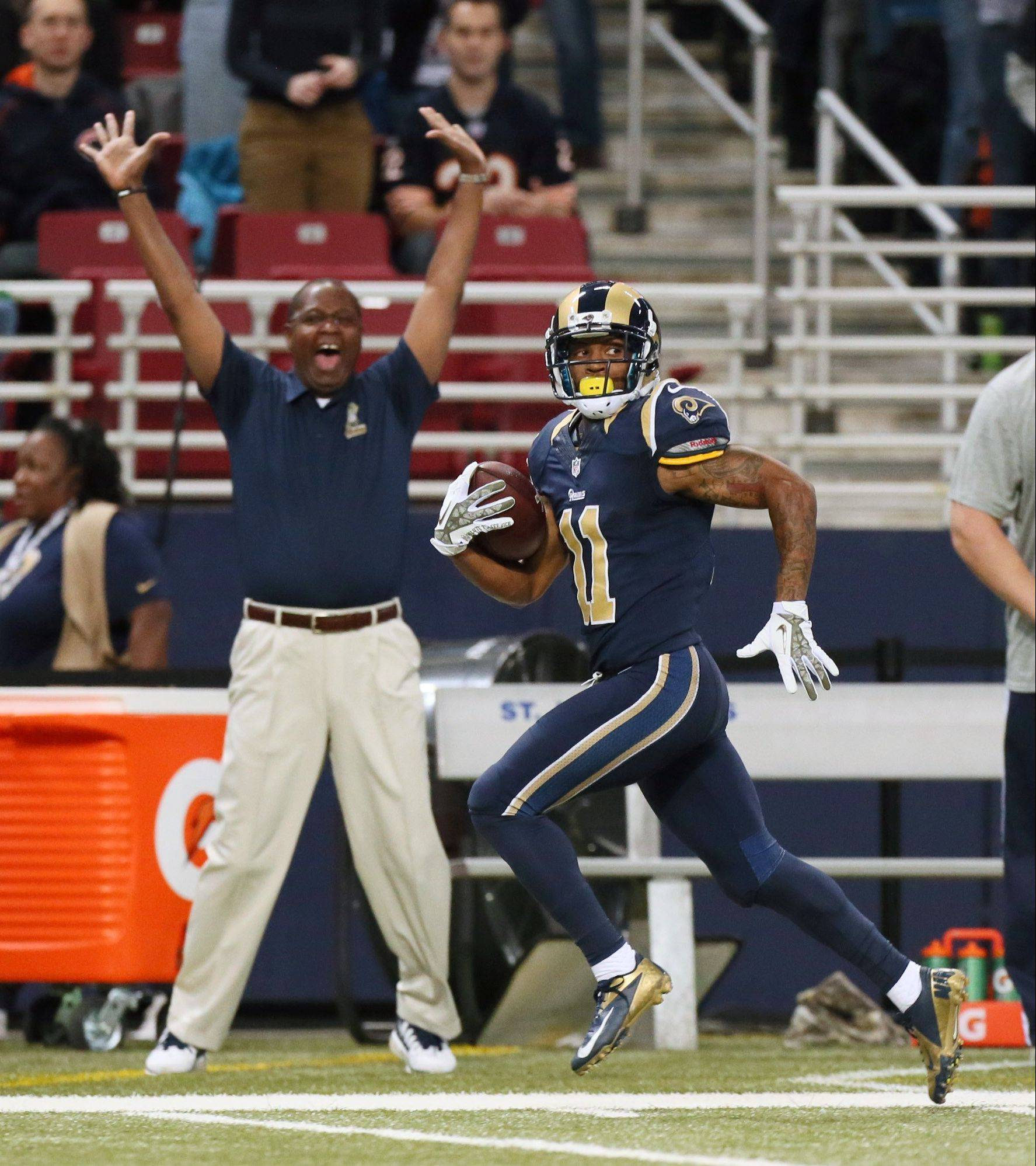 Tavon Austin gallops for a 65-yard touchdown run on the Rams� first possession Sunday.