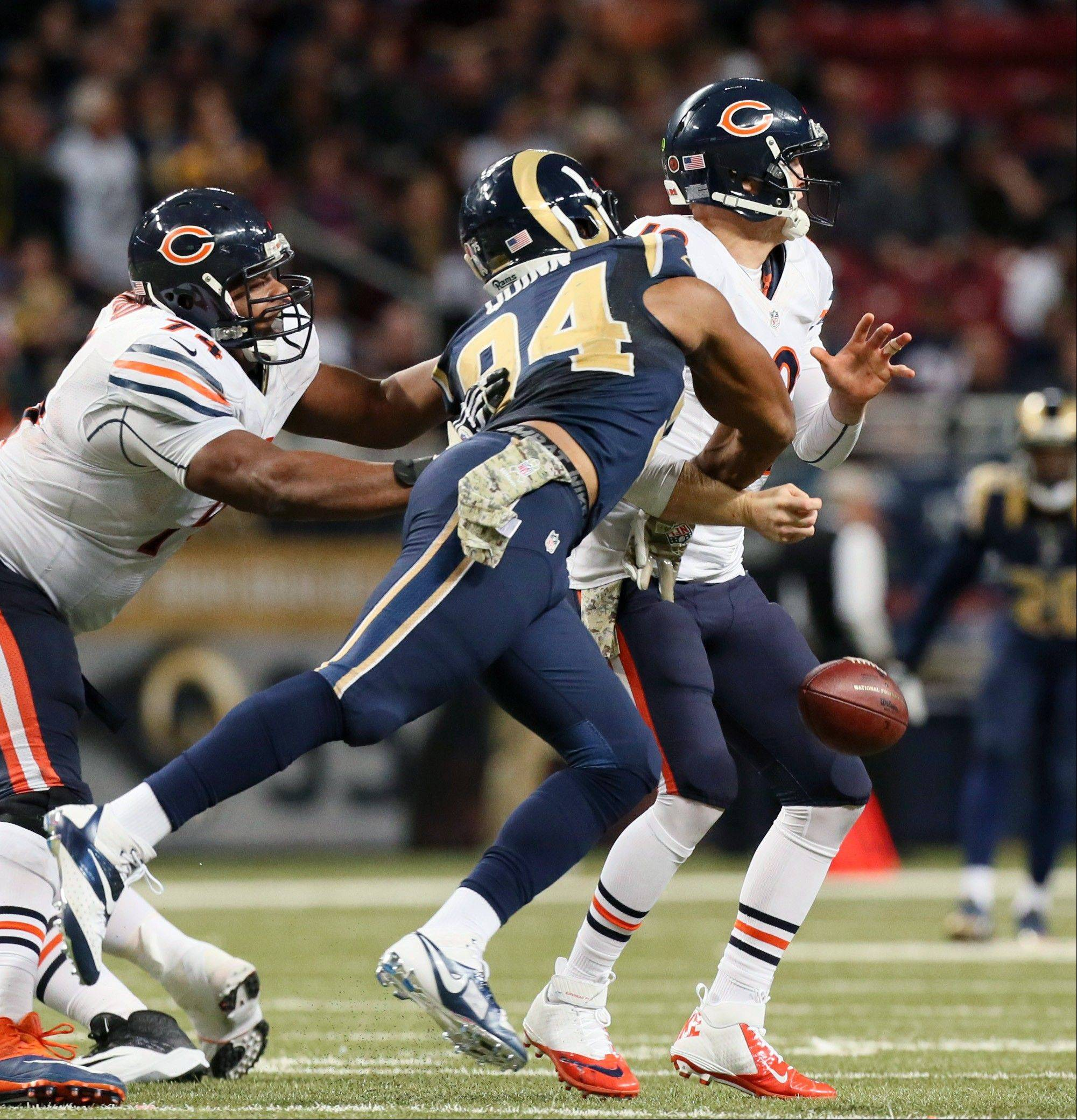 St. Louis Rams defensive end Robert Quinn beats Chicago Bears Jermon Bushrod for a sack on Bears quarterback Josh McCown and Quinn forces a fumble during the second half of an NFL football game on Sunday, Nov. 24, 2013, in St. Louis.