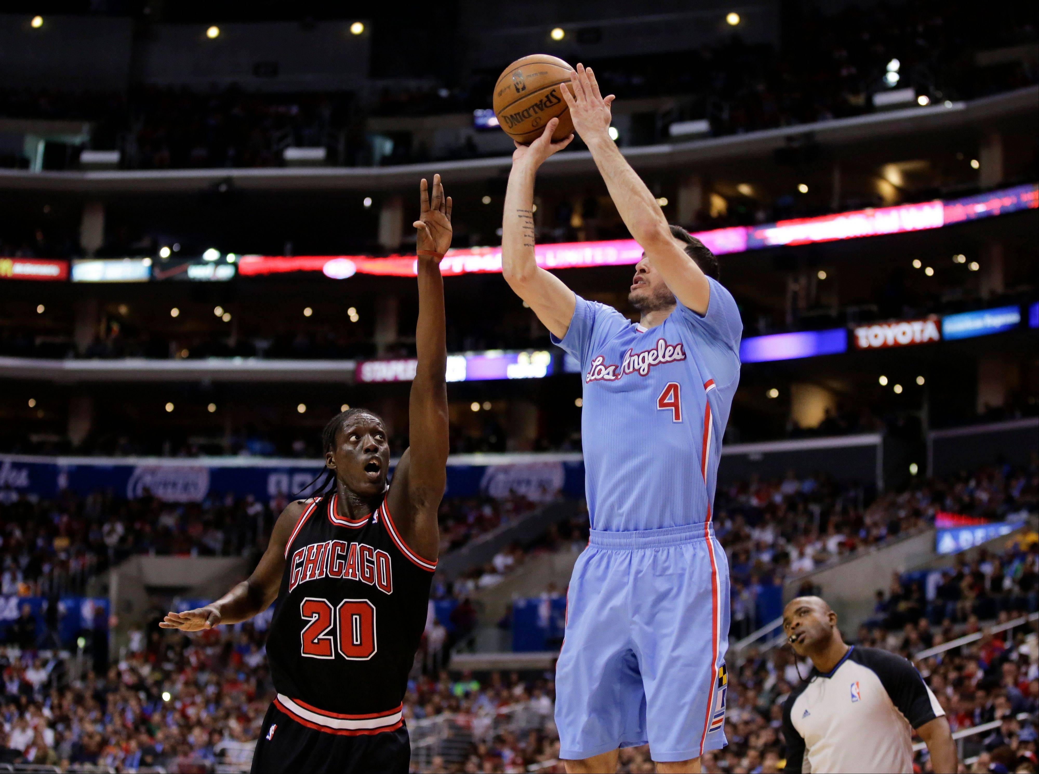 Los Angeles Clippers guard J.J. Redick (4) shoots over Chicago Bulls forward Tony Snell during the first half of an NBA basketball game in Los Angeles, Sunday, Nov. 24, 2013.