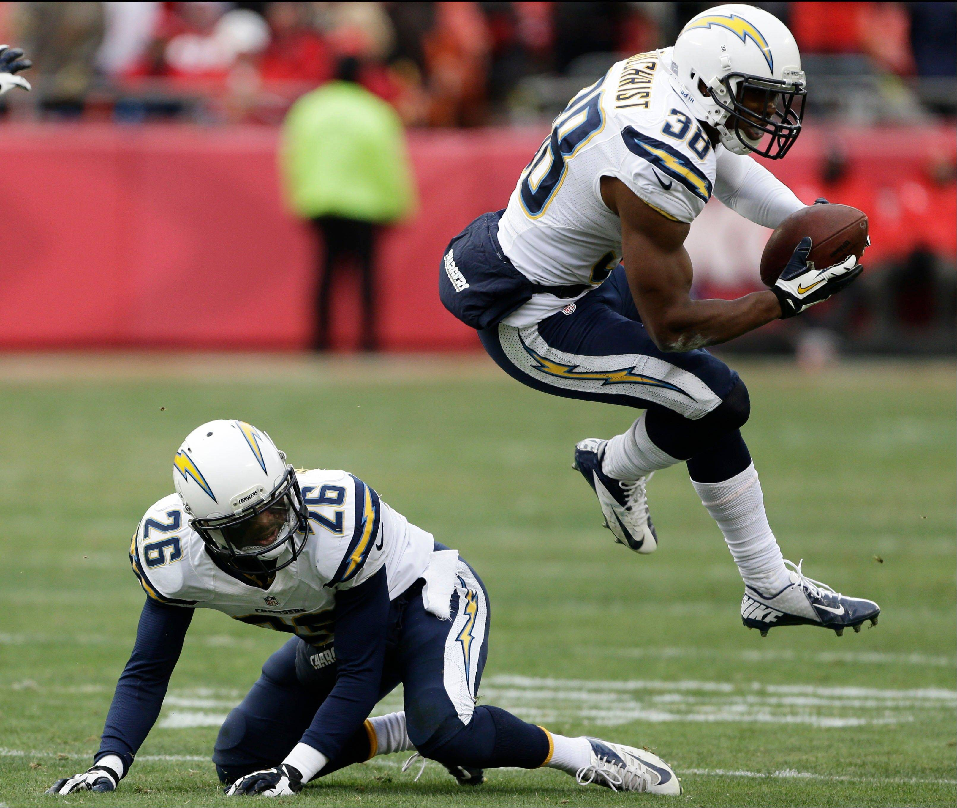 San Diego Chargers strong safety Marcus Gilchrist (38) jumps over cornerback Johnny Patrick (26) after making an interception during the second half of an NFL football game against the Kansas City Chiefs in Kansas City, Mo., Sunday, Nov. 24, 2013.