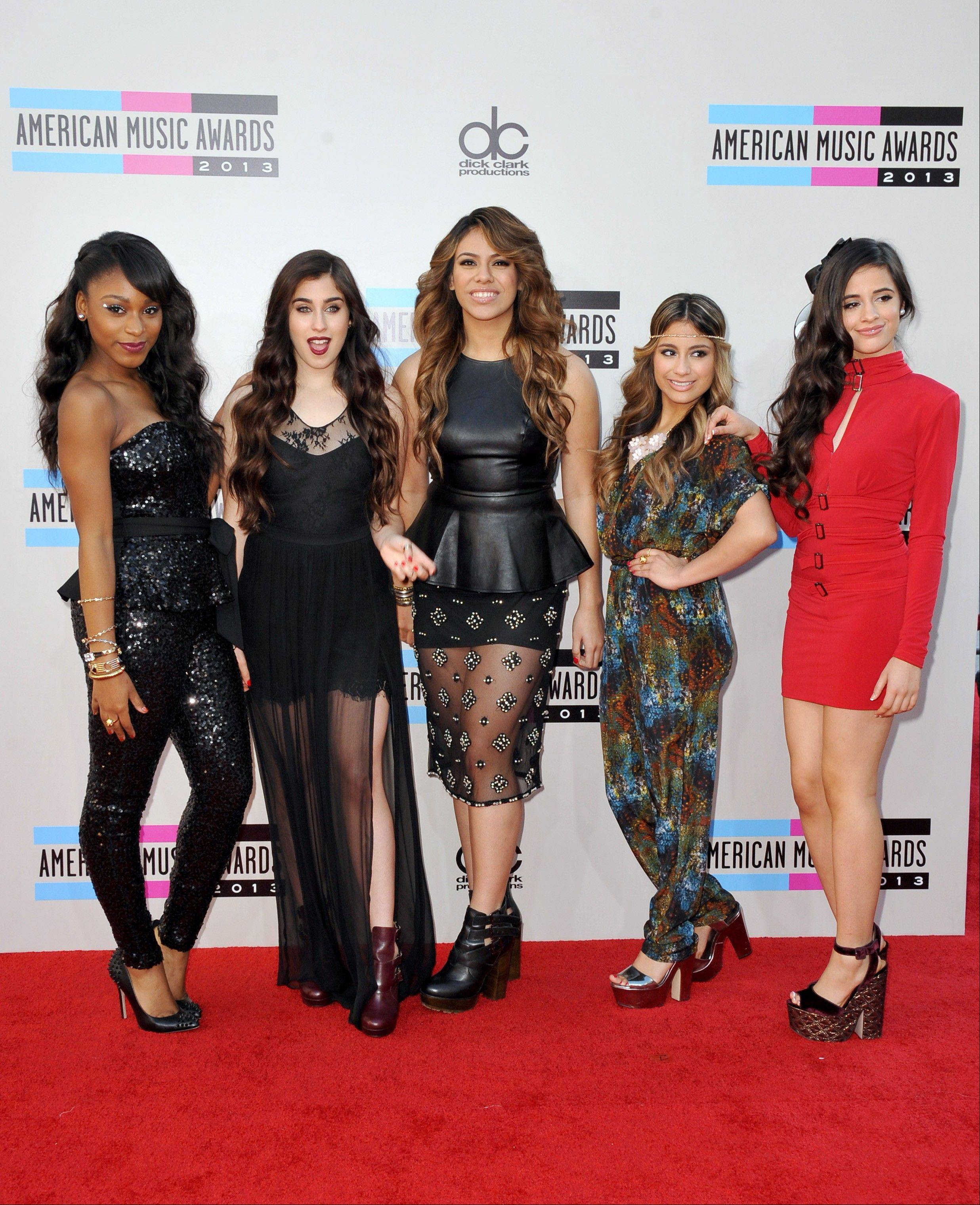 "Members of the ""X Factor"" created group Fifth Harmony, from left, Normani Kordei, Lauren Jauregui, Dinah Jane Hansen, Ally Brooke, and Camila Cabello arrive at the American Music Awards at the Nokia Theatre L.A. Live on Sunday in Los Angeles."