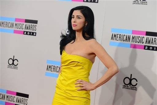 Comedian Sarah Silverman trades her usual less casual attire for something a little more chic at the American Music Awards.