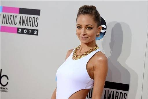 Nicole Richie walks the red carpet ahead of the AMAs.